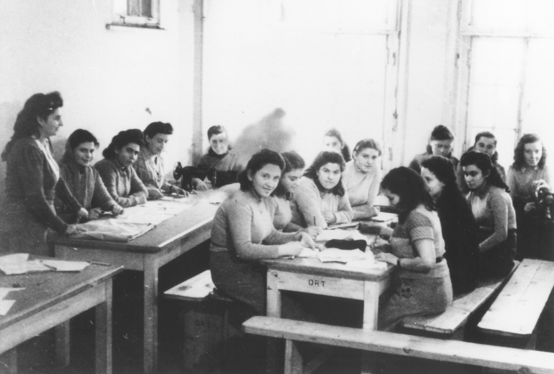 Young women attend a sewing class at the ORT school in the Schauenstein displaced persons camp for children.
