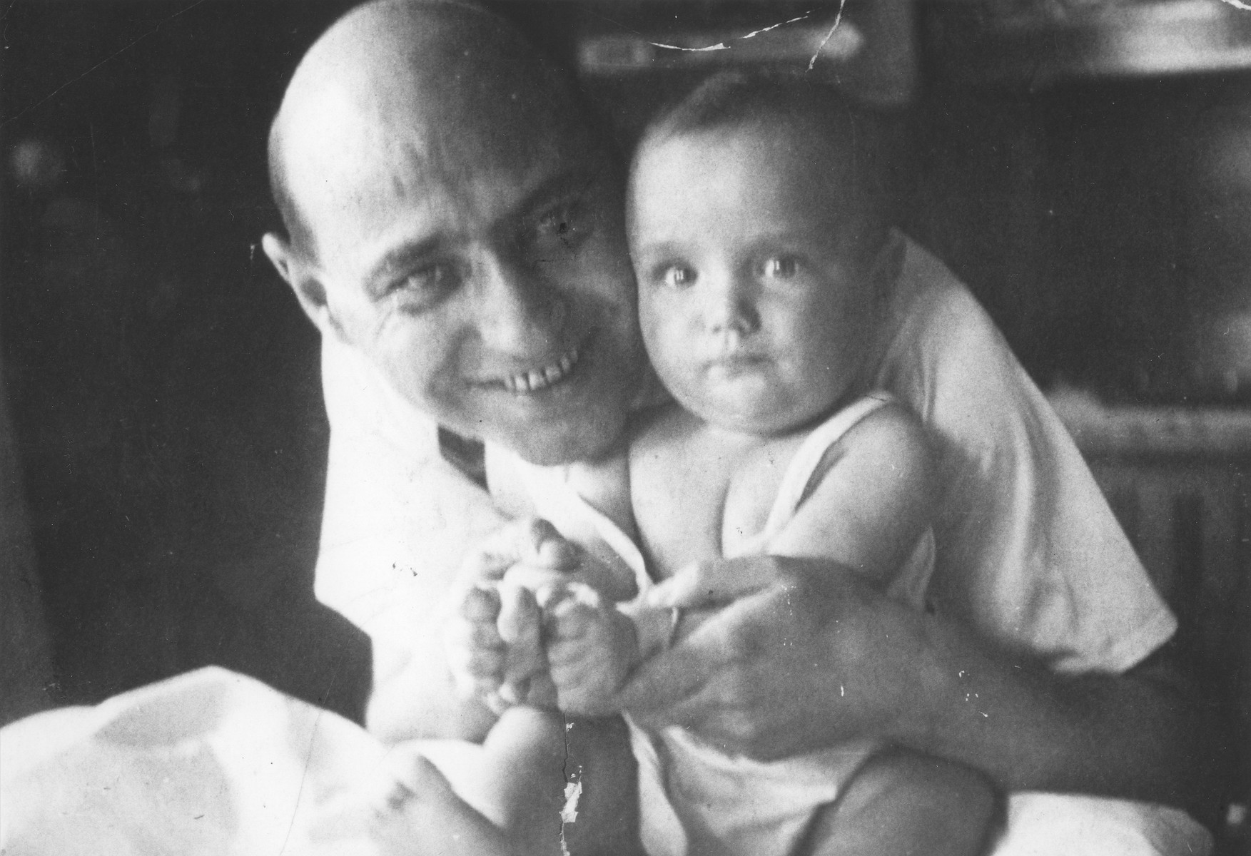 Portrait of a Jewish father holding his infant son.  Pictured are Dr. Brunno Deutsch and his son Bedrich.