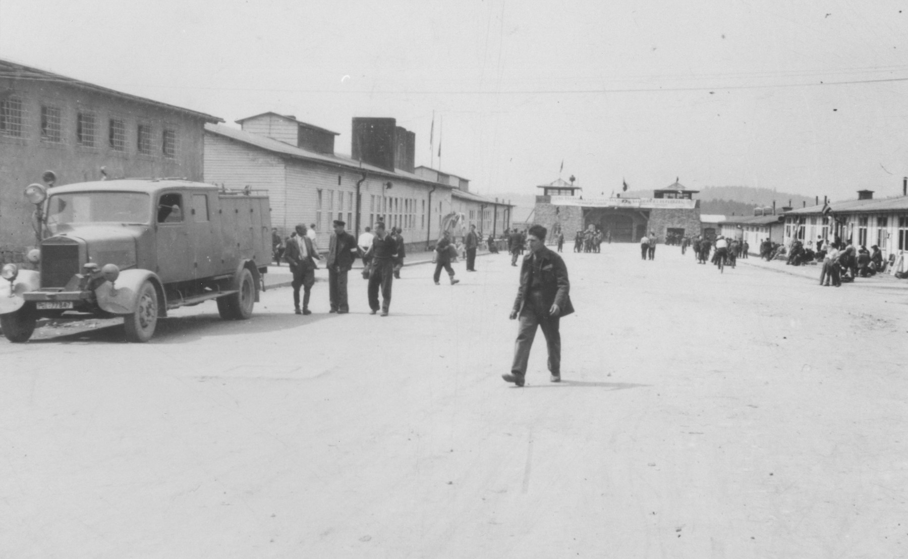 American liberators and survivors walk on the main street of the Mauthausen concentration camp.