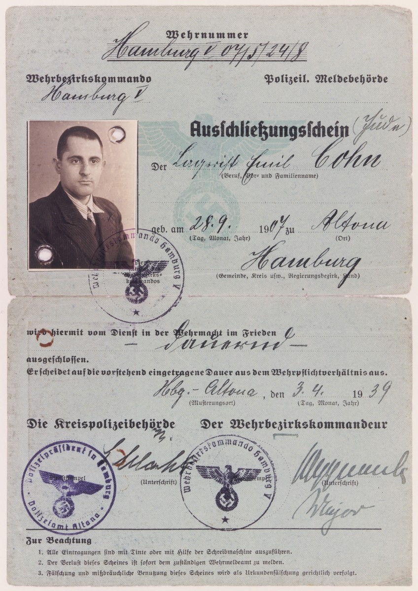 "Certificate of exclusion issued by the District Police of Hamburg to Emil Cohn (b. September 28, 1907 in Altona) on April 3, 1939, stating that the holder is prohibited from serving in the military during peacetime because he is a Jew.  The document lists Cohn's occupation as ""Lagerist"" [camp inmate]."