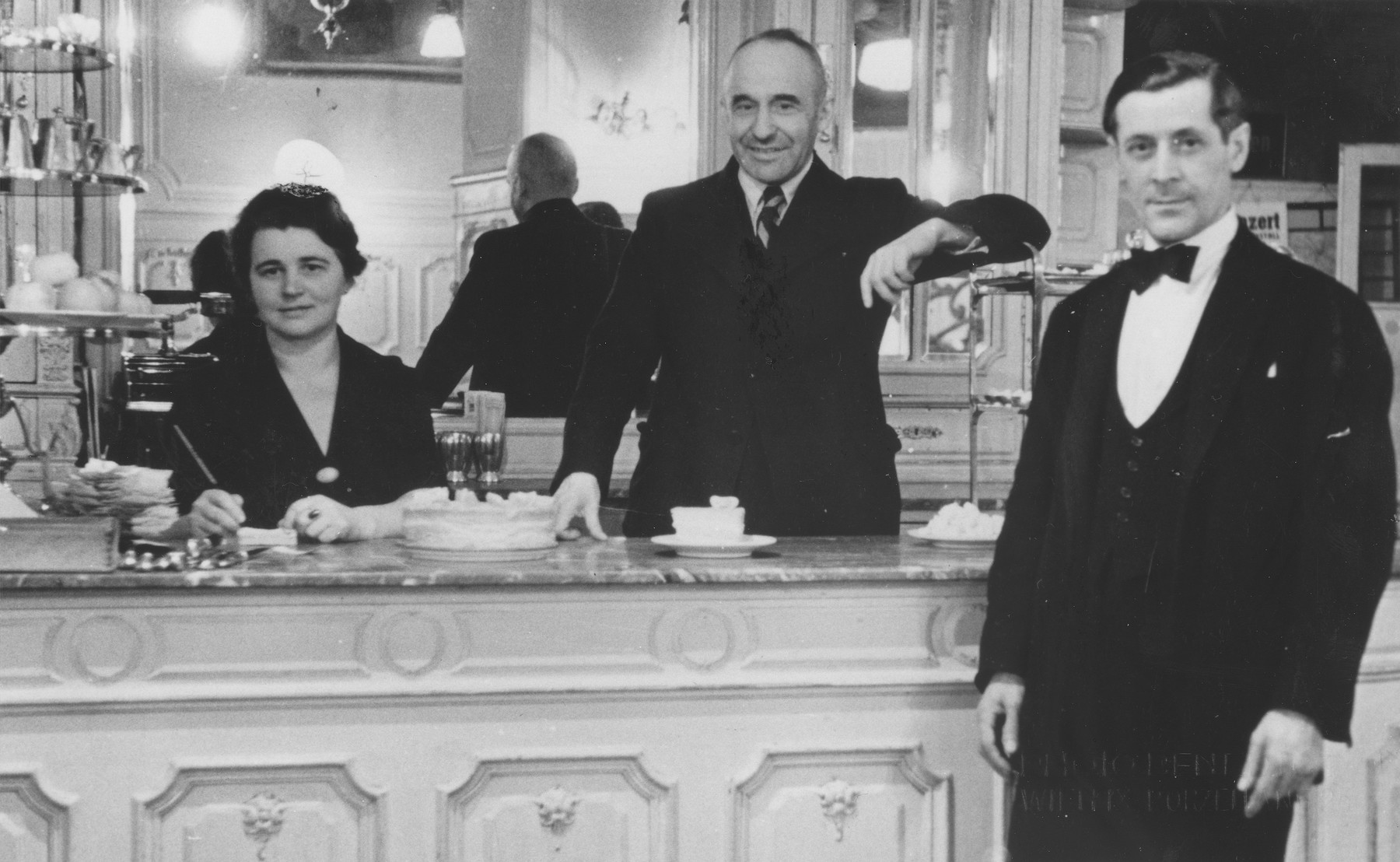 Arthur Mayer stands behind the counter of his coffee house in Vienna.