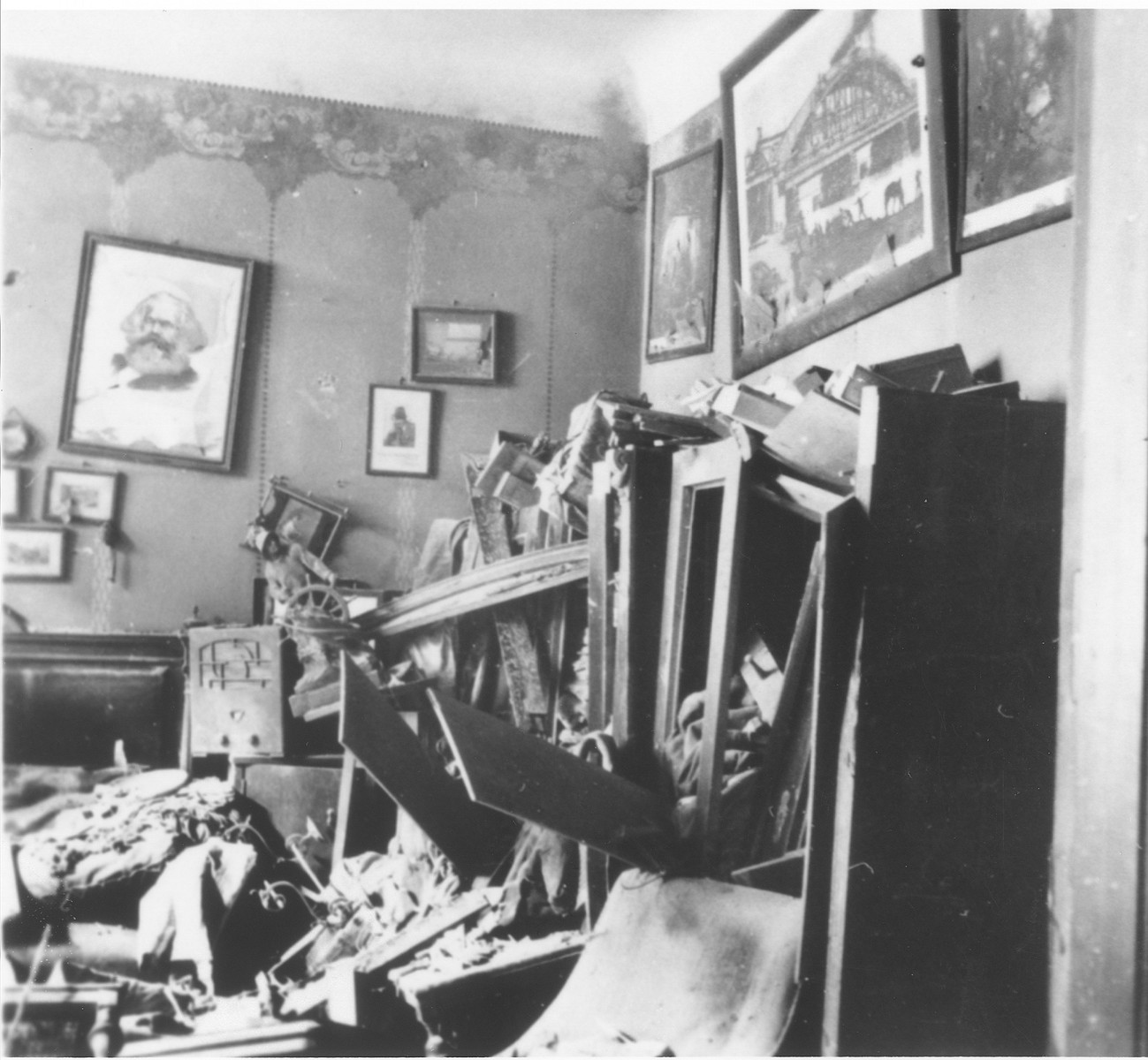 A stereoscoptic image depicting the vandalized apartment of a German worker.  A defaced portrait of Karl Marx hangs on the wall.