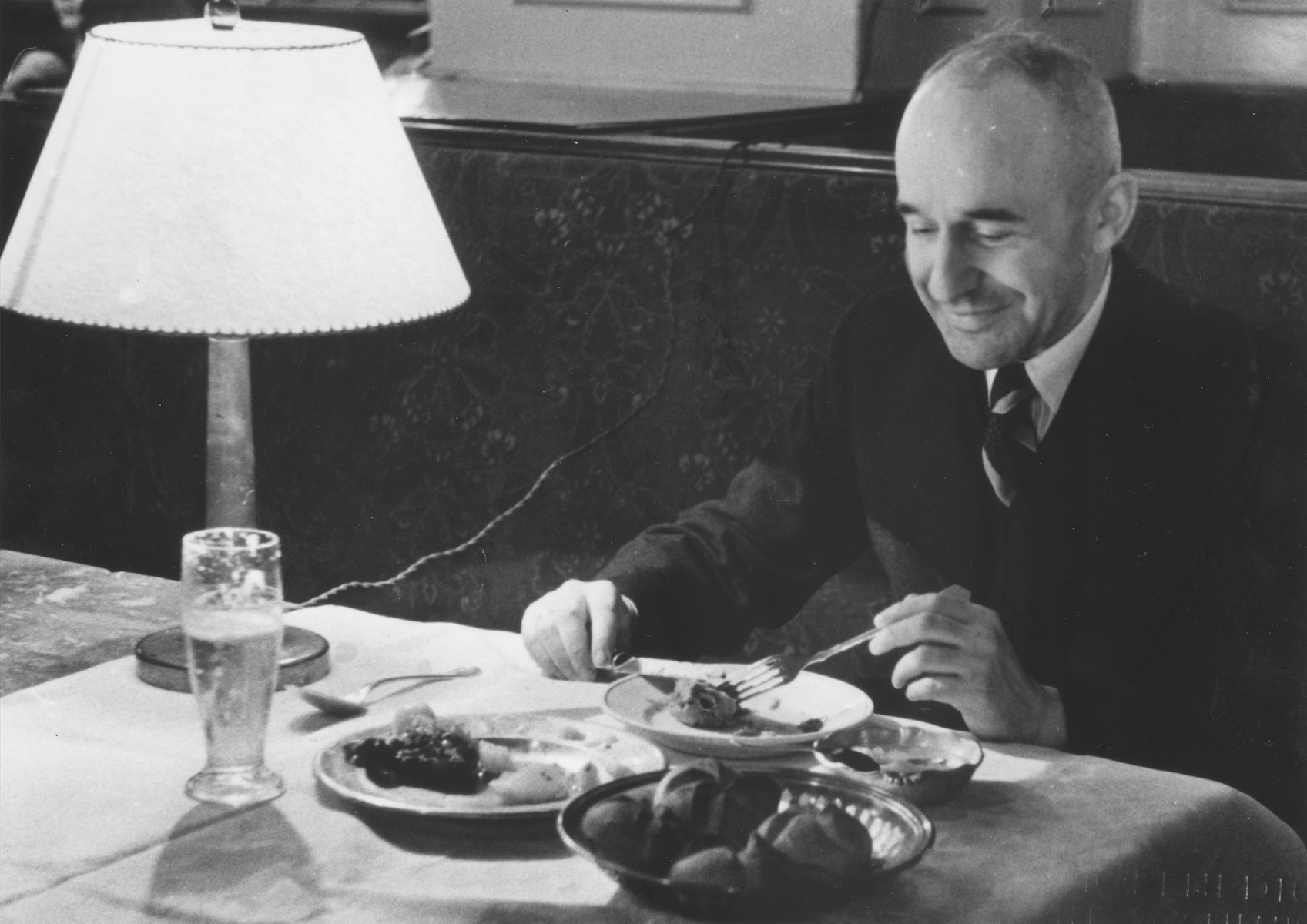 Jewish restauranteur Arthur Mayer eats a meal at his coffee house in Vienna.