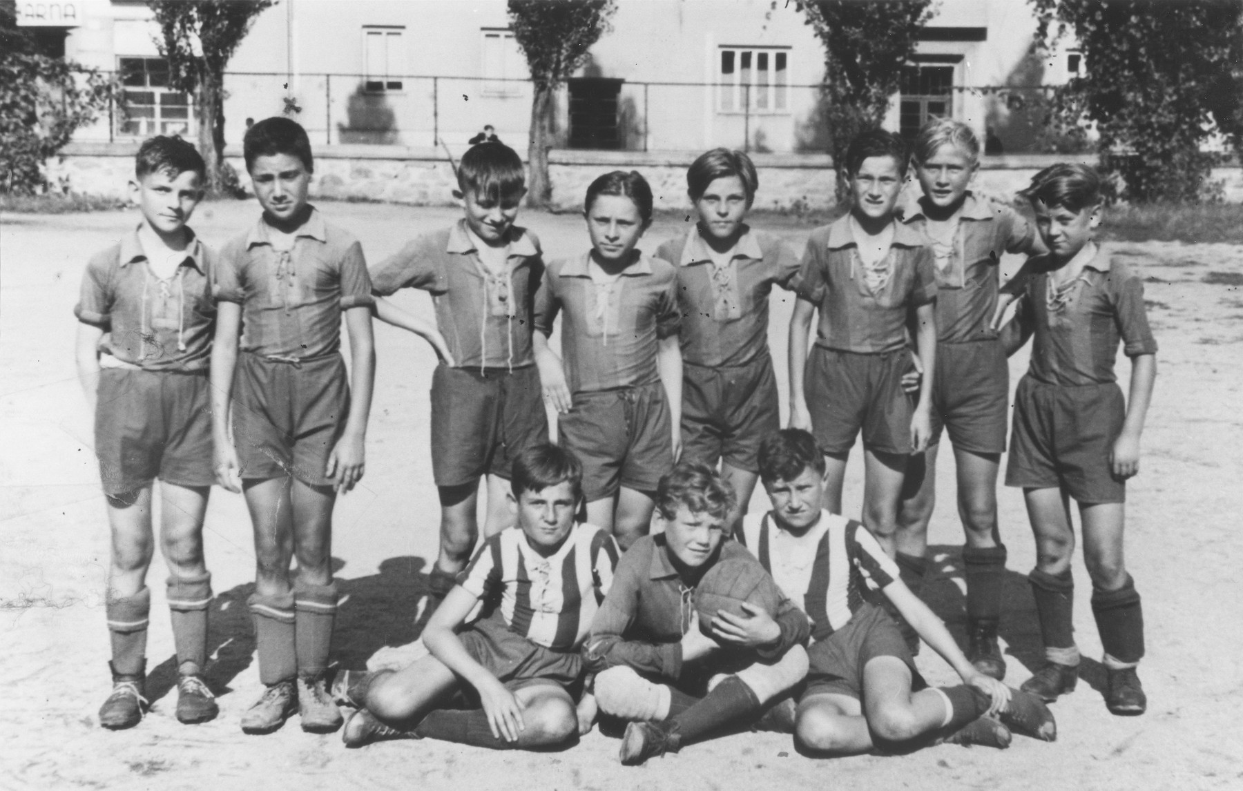 Bedrich Deutsch (standing second from the left) poses with the other members of a soccer team in Znojmo, Moravia.  He is the only Jew in the group.