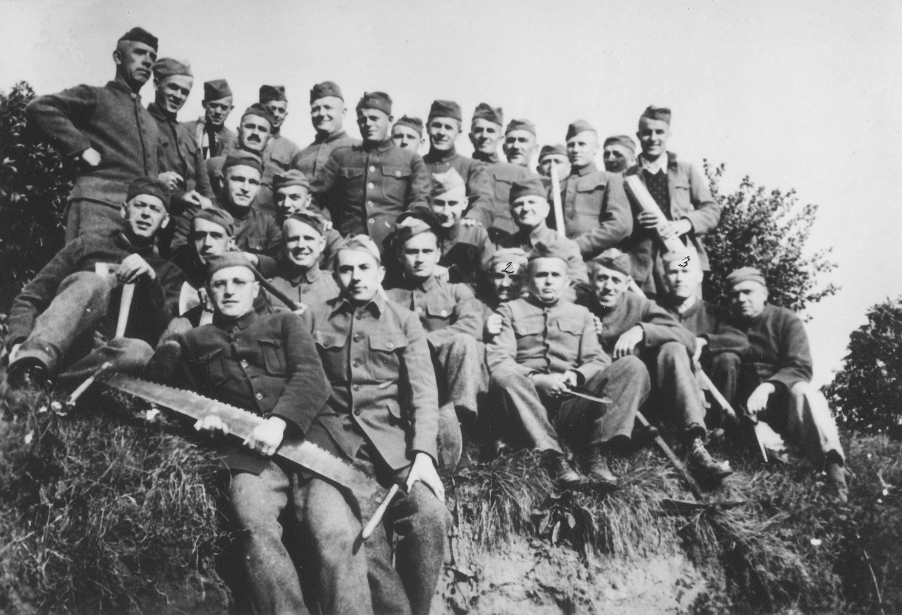 Group portrait of Czech political prisoners interned in Theresienstadt who were put to work felling trees.  Among those pictured is Oskar Bartolsic.