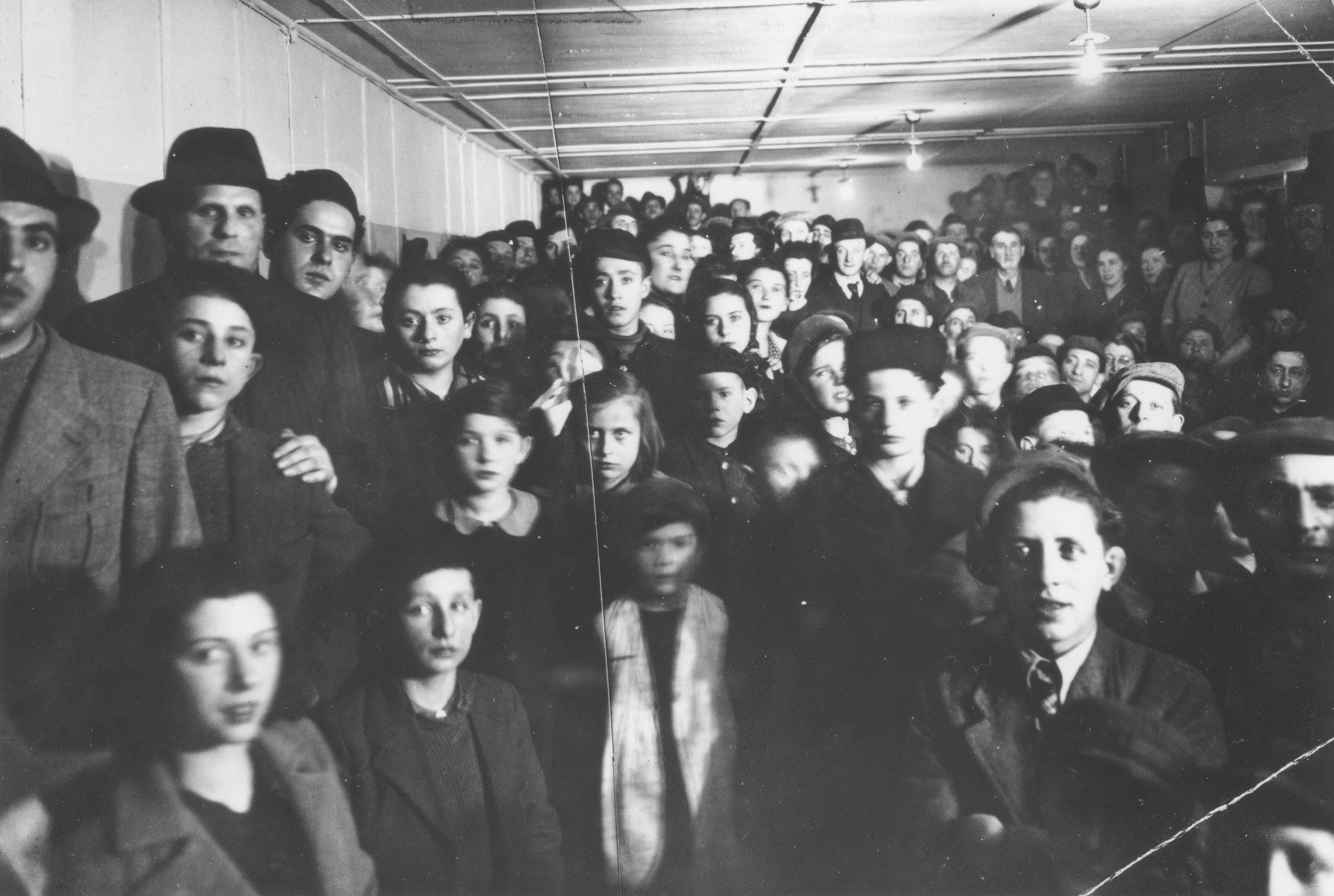 DPs gather for the opening of the synagogue at the Schlachtensee displaced persons camp.
