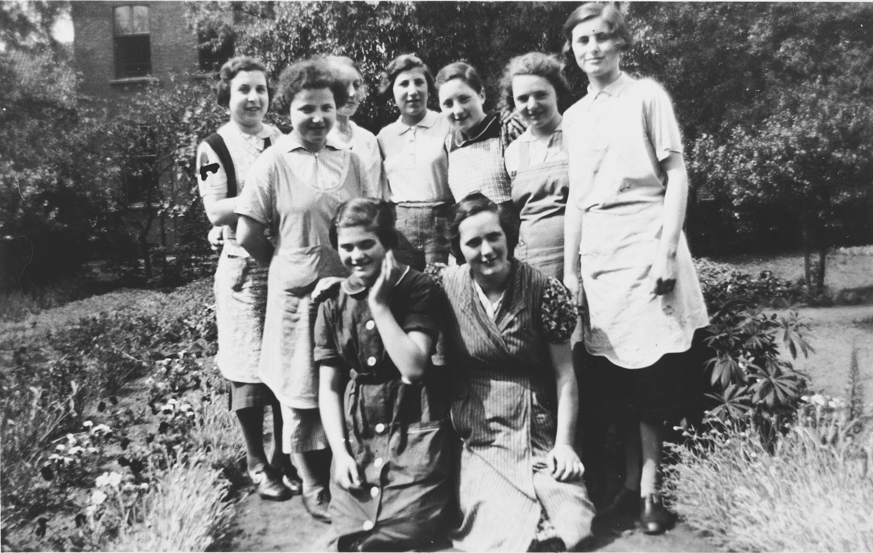 Group portrait of Jewish girls and teenagers in the Orthodox orphanage in Dinslaken, Germany prior to Kristallnacht  Pictured standing on the far right is Ruth Herz.