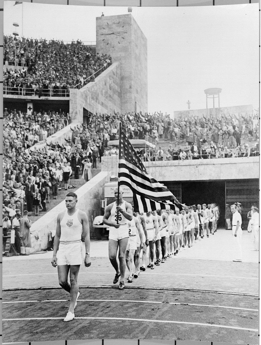 American athletes, participating in a United States-German friendship track and field competition, march onto the field at the Olympic stadium in Berlin.  The competition was sponsored by Avery Brundage and the U.S. Olympic Committee.