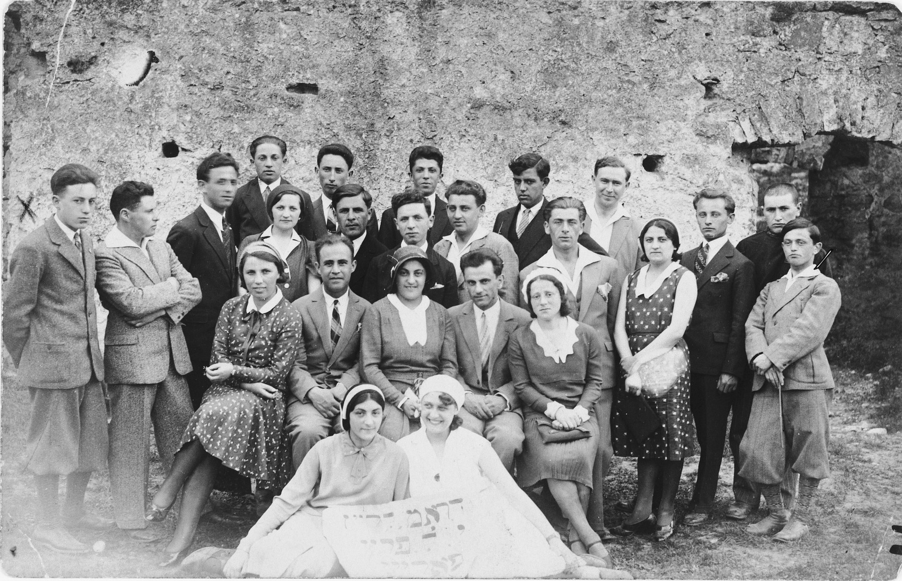 Group portrait of members of the I.L. Peretz drama club in Czortkow.  Clara Bezner is in the front left.