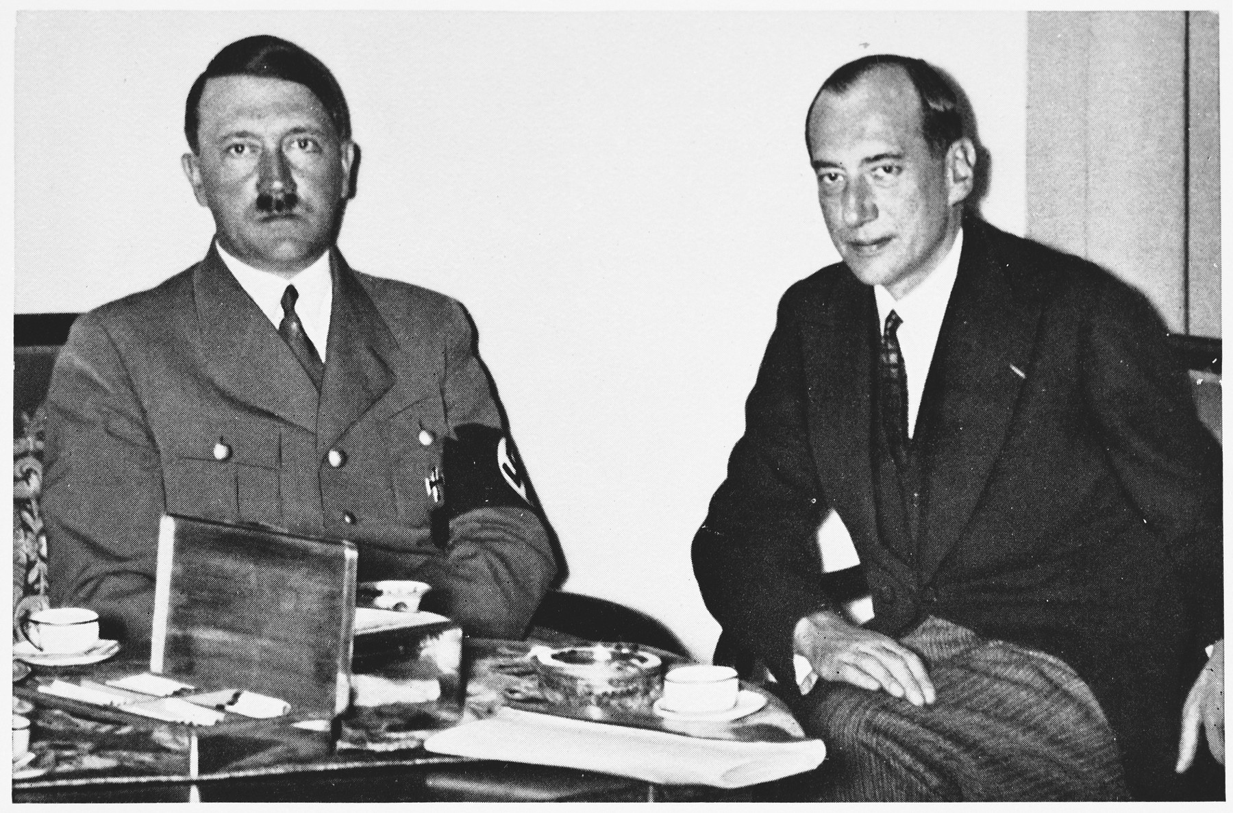 Adolf Hitler meets with the Polish Foreign Minister Jozef Beck.   On the back of the photograph is printed an advertisement for a volume of collected photographs of Adolf Hitler, edited by the official NSADAP Reich photographer, Heinrich Hoffmann.