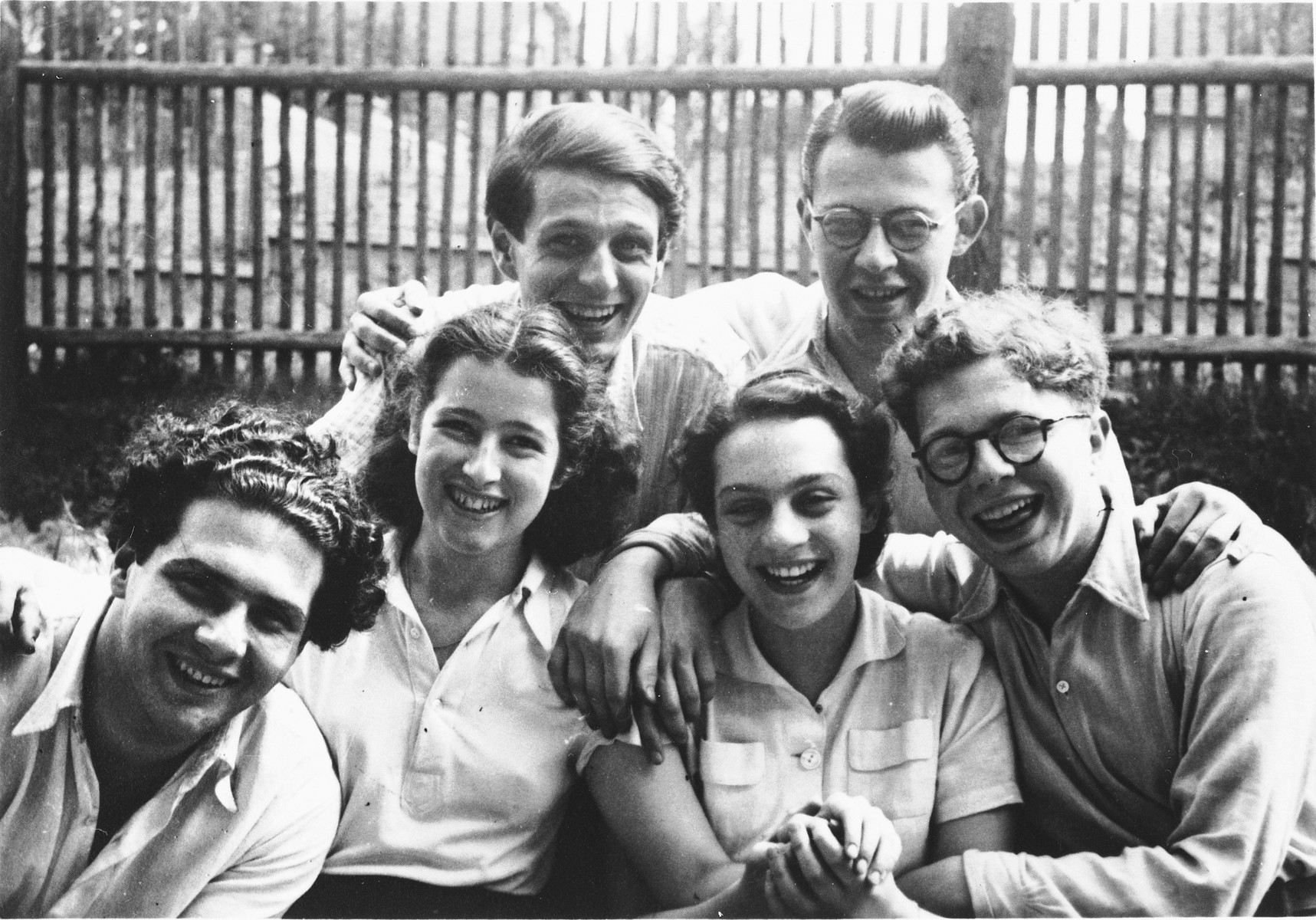 A group of young Jewish friends pose outside in Prague during the Nazi occupation.  Pictured are Peter Hirsch, Rudolph Rychnofsky, Gerhard Kobler, Mushka Bulati, Susanna Bandler and Hans Osers.  Peter Hirsch was killed on the way to Terezin.  Mushka Bulati, Susanna Bandler and Hans Osers survived.