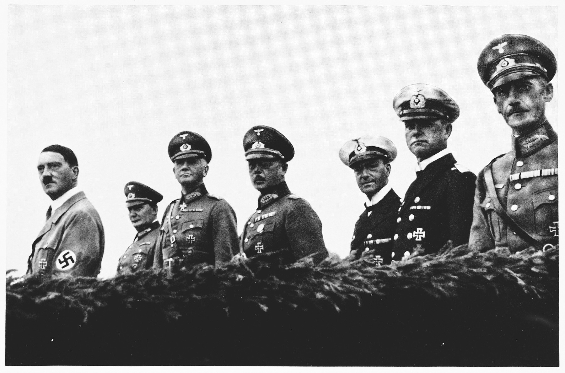 Hitler poses with members of the High Command during Wehrmacht Day celebrations.   Pictured from left to right are: Hitler, Hermann Goering, Werner von Blomberg, Werner von Fritsch, and Erich Raeder.