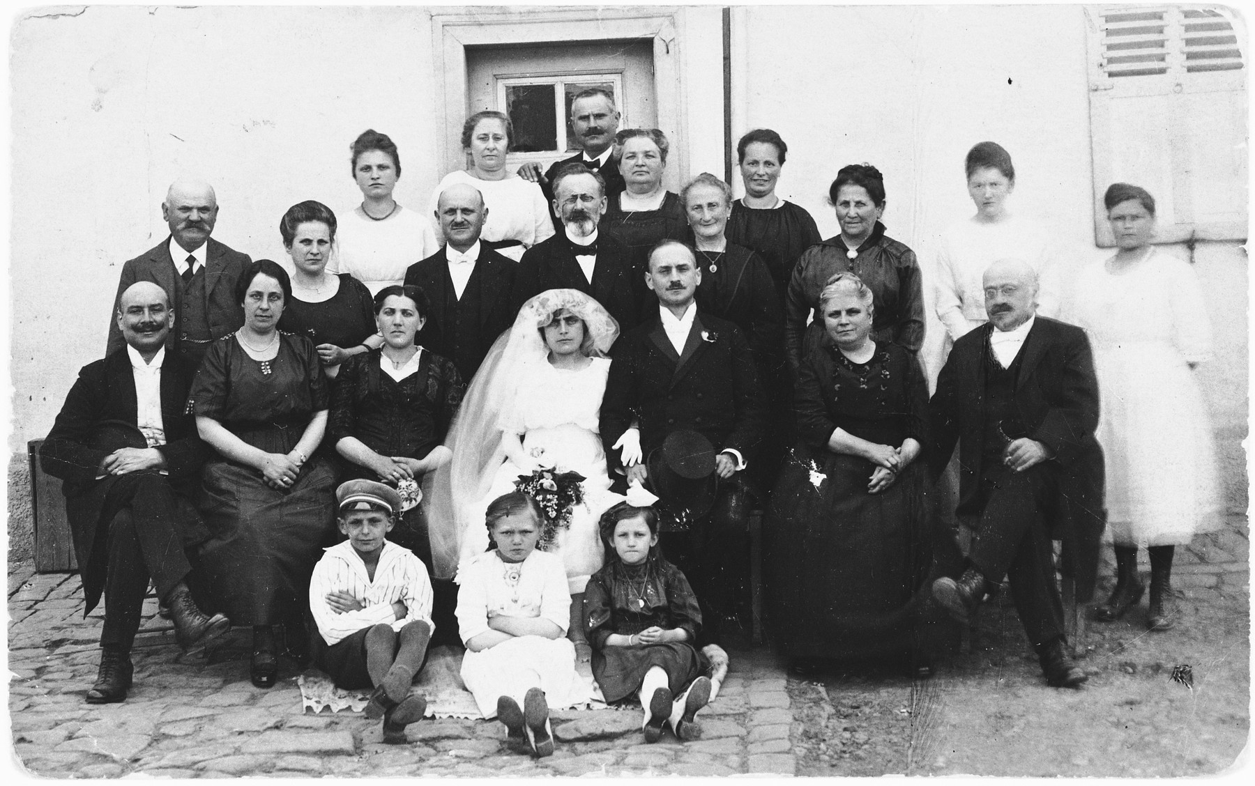 Group portrait of relatives and guests at the wedding of Lilly Weinberg and Eugene Herz.