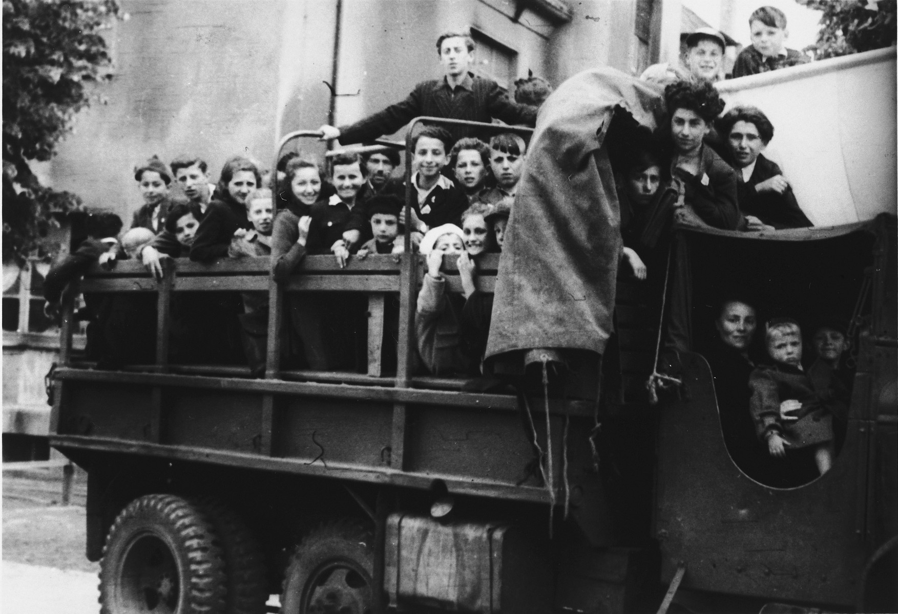 School children from the Eschwege displaced persons' camp board a truck for a Lag B'Omer excursion.
