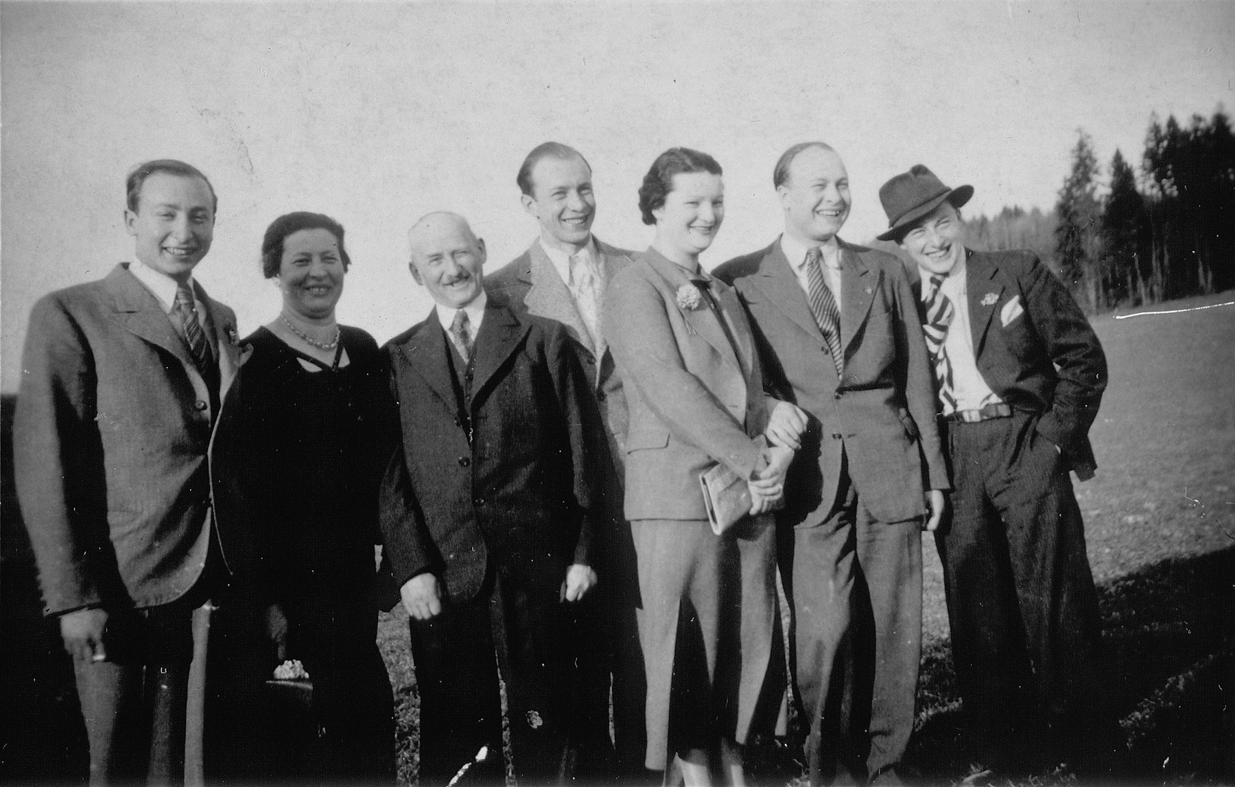 The Blechner family, a Polish-born Jewish family in Germany, poses outside.    Left to right are Salo, Mina, Markus, Oskar, Friedl, Jakob, and Leo Blechner.