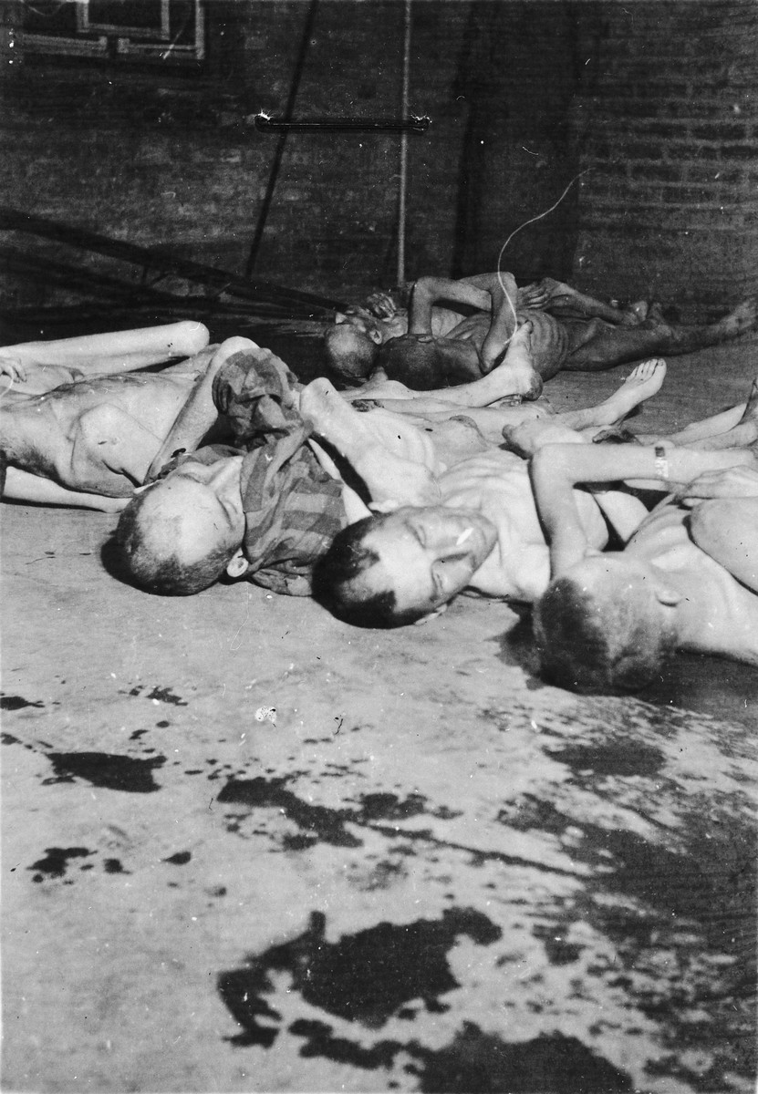 Corpses lie on the ground outside the crematorium in the newly liberated Mauthausen concentration camp.