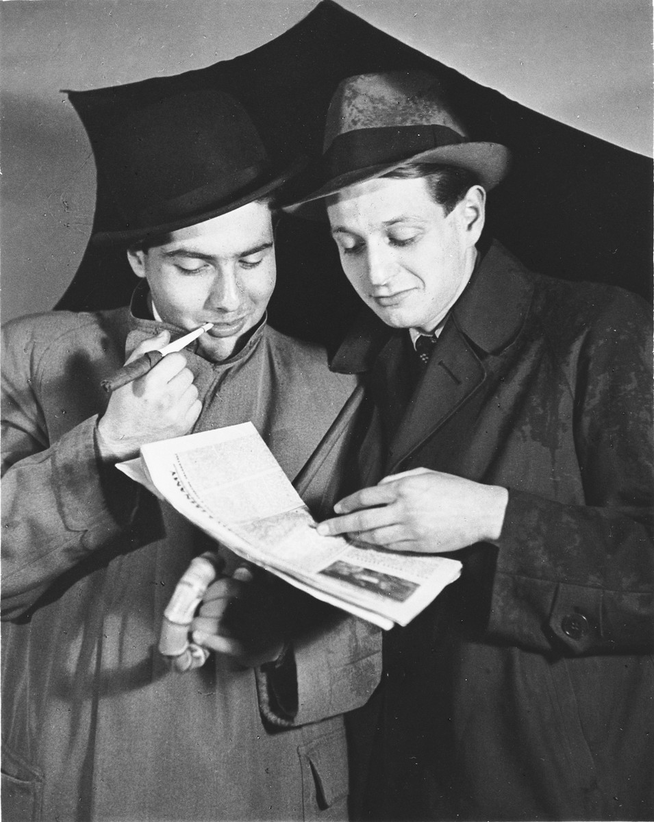 Two young men give a theatrical performance at a drama club made up of young Jews who came together to entertain themselves while under the Nazi occupation.  Pictured are Peter Hirsch and Rudolph Rychnofsky.