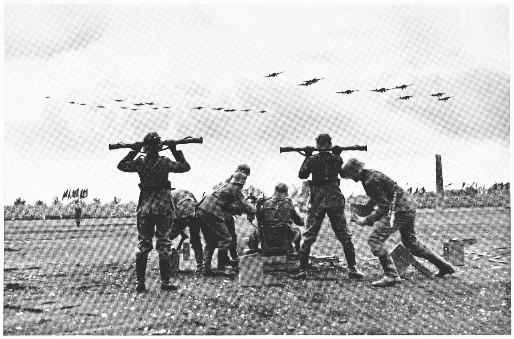 "A demonstration of anti-aircraft batteries at the ""Wehrmacht Day"" of the Reichsparteitag in 1935."