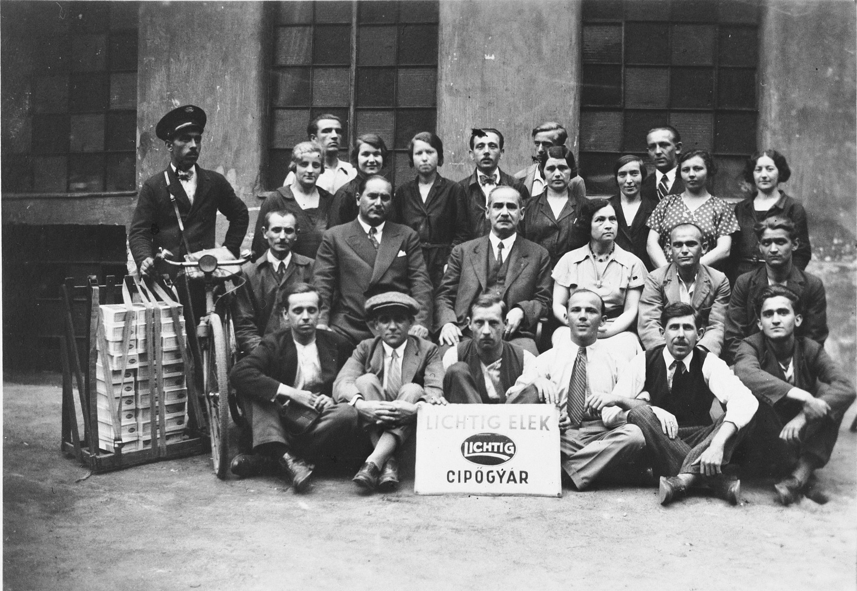 Group portrait of the employees of Elek Lichtig's shoe factory in Budapest, Hungary.