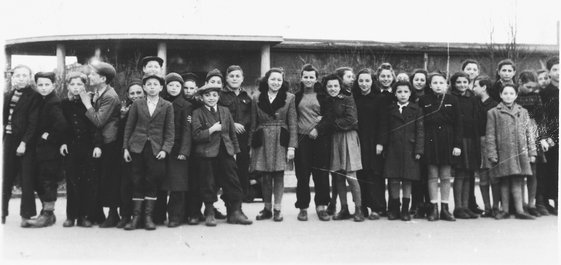 Group portrait of the Betar Zionist youth group in the Eschwege displaced persons' camp.