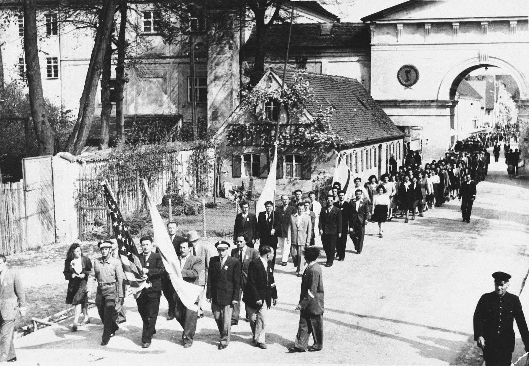 Jewish displaced persons in Tuerkheim march in a memorial parade on the anniversary of the liberation of a concentration camp.