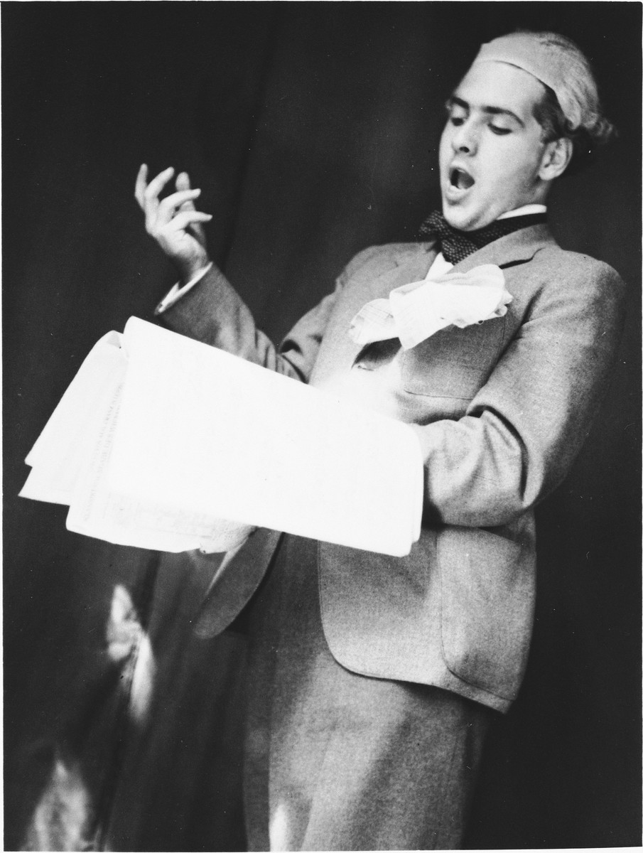 A young man gives a theatrical performance at a drama club made up of young Jews who came together to entertain themselves while under the Nazi occupation.  Pictured is Peter Hirsch.