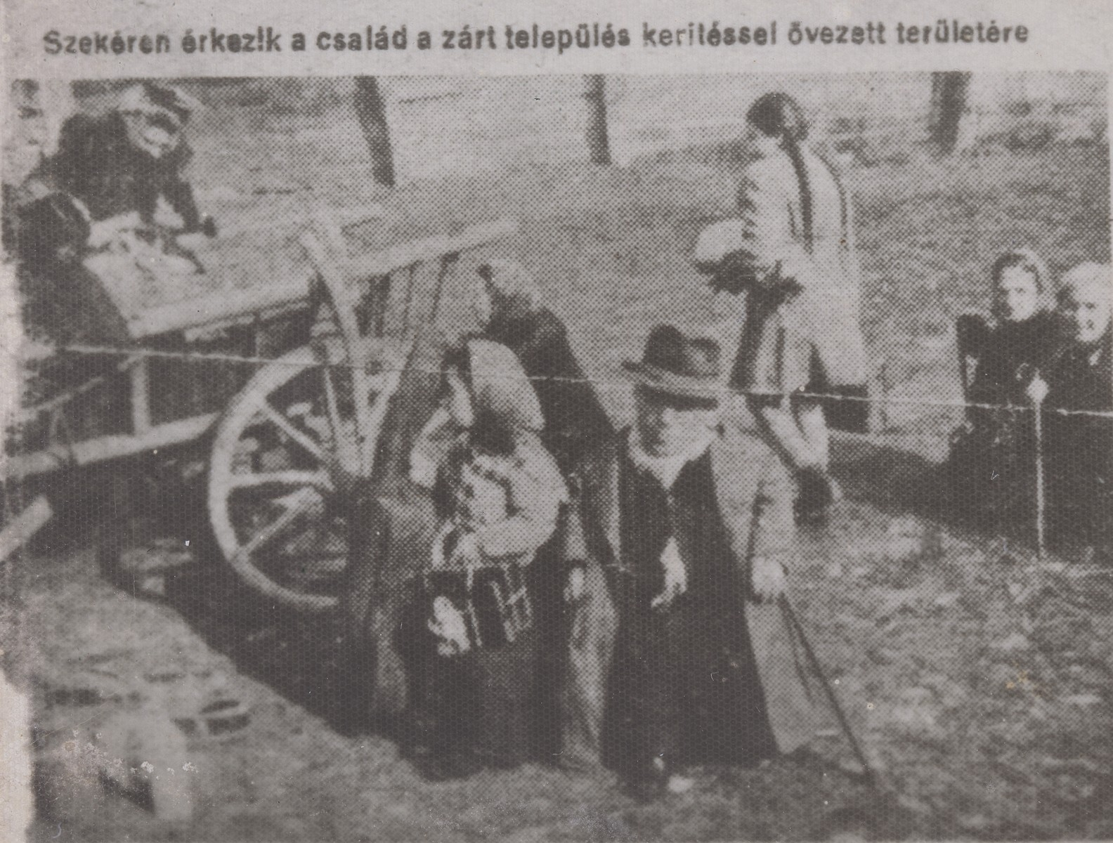 "Members of the Ovici family arrive by farm wagon to the ghetto of Dragomiresti prior to their deportation to Auschwitz.  The original newspaper caption reads: ""The family arrives to the closed residential area which is surrounded by a fence.  They arrived on this horse-drawn wagon."""