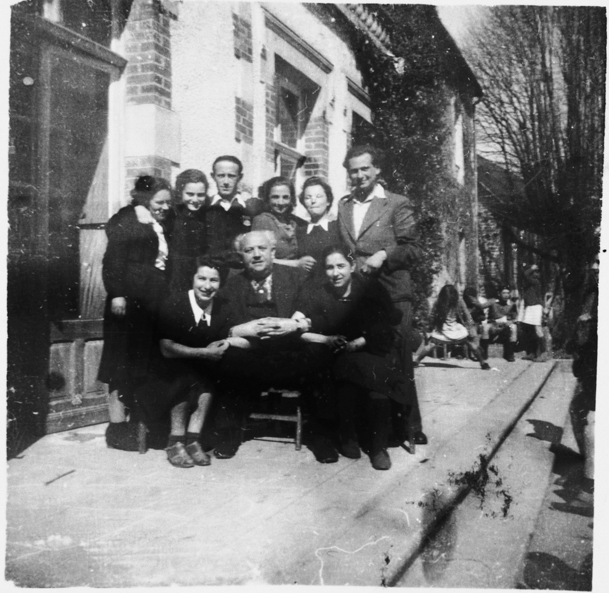 Group portrait of the staff of the Chabannes OSE [Oeuvre de Secours aux Enfants] children's home.   Standing from left to right are: Gita, Milia, Dr. Meiseles, Ida, Herta and Simon.  Seated are Rachel, Felix Chevrier and Mrs. Sitzman.  Felix Chevrier was honored as Righteous Among the Nations in 1999.