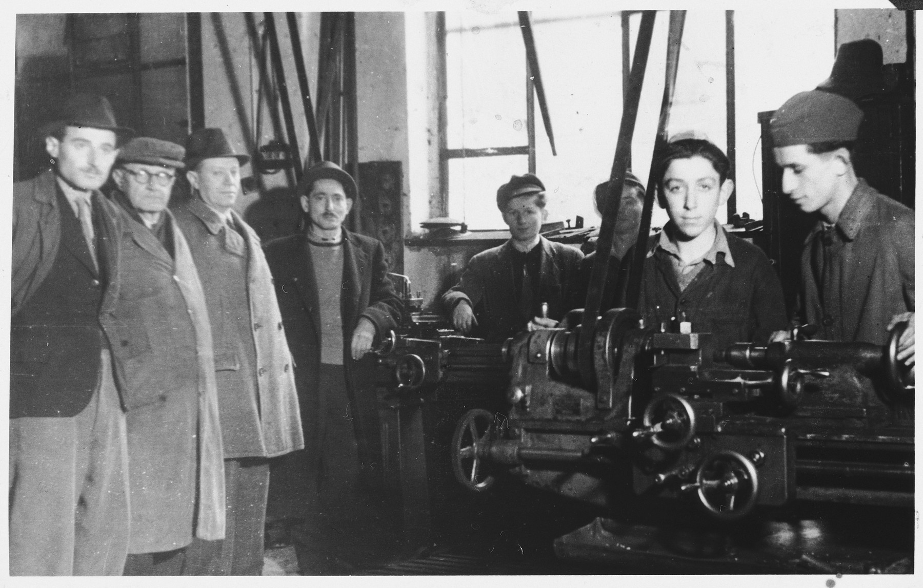 Jewish DP youth learn to operate machine tools in a hachshara (Zionist collective) in Kosice.  Izidor Neugreschel is third from the left.  Erwin Buncel is fifth from the left in the center.   Staring directly at the camera is Frank Lowy (then Feri Lowy).