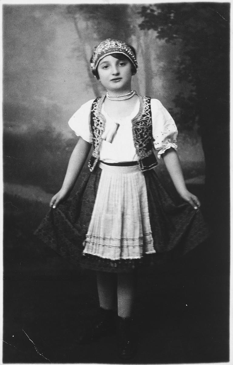 Studio portrait of Marta Buncel in her dance costume.