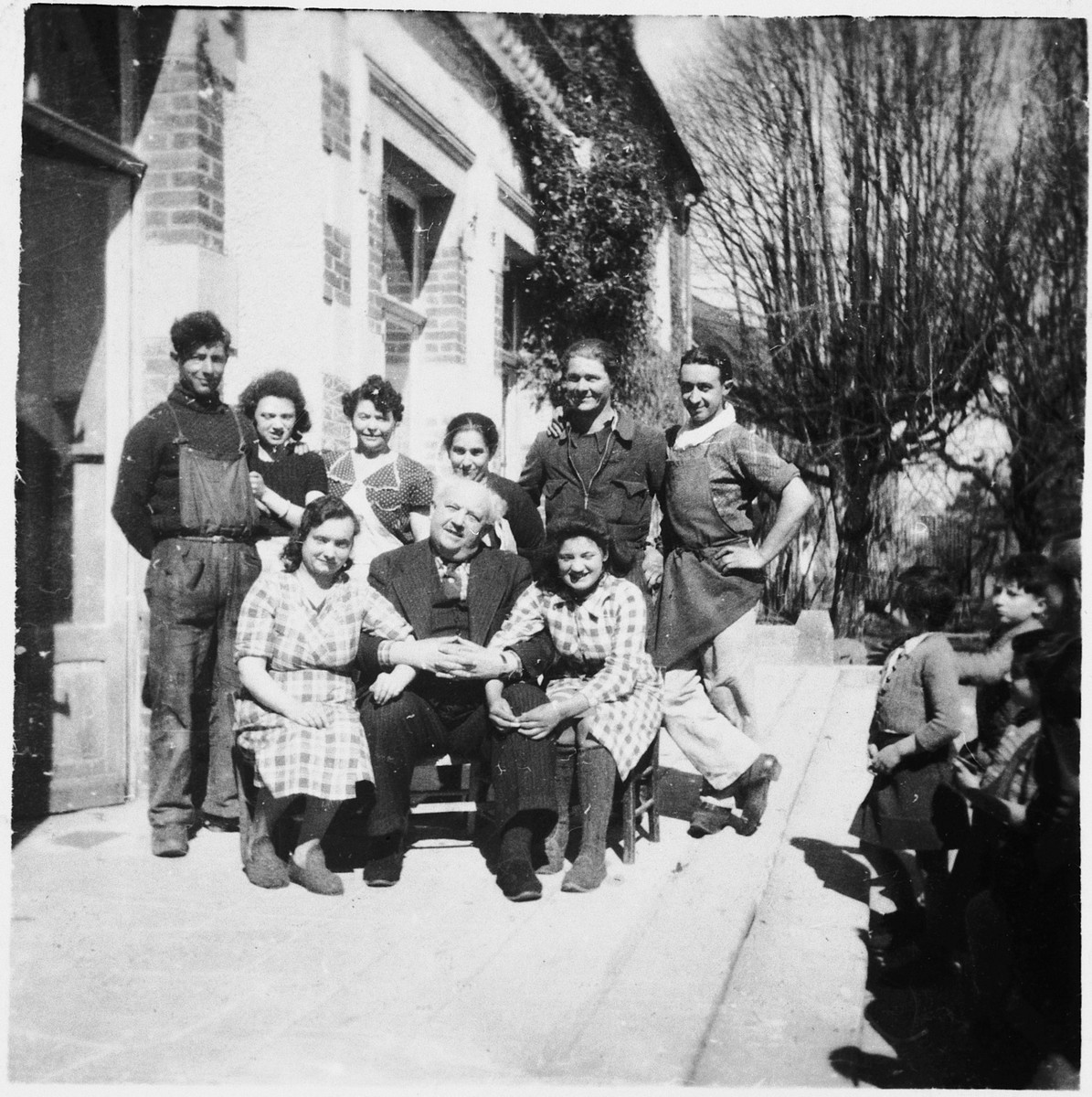 Group portrait of the support and technical staff of the Chabannes OSE [Oeuvre de Secours aux Enfants] children's home.   Seated in the center is the director, Felix Chevrier.  Felix Chevrier was honored as Righteous Among the Nations in 1999.