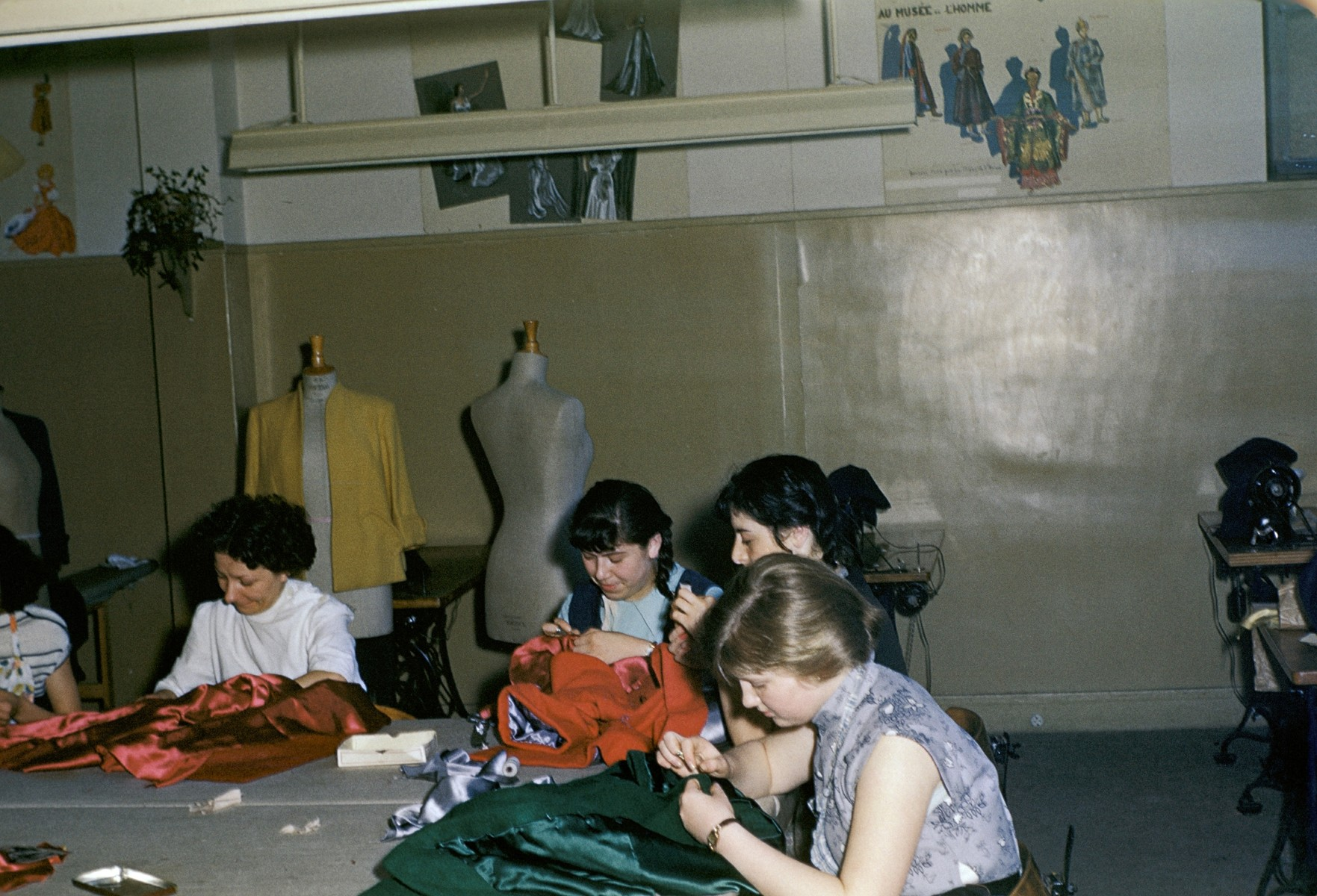 Jewish women learn sewing and tailoring in an ORT workshop in an unidentified DP camp.
