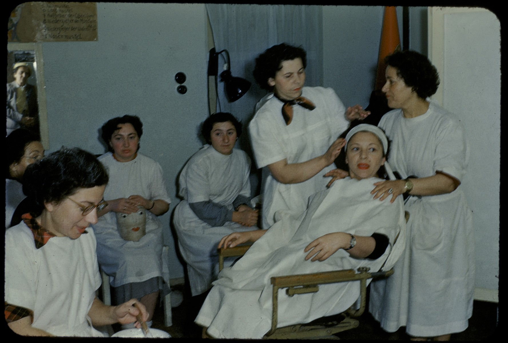 Women learn to become beauticians at an ORT school in the Foehrenwald displaced persons camp.