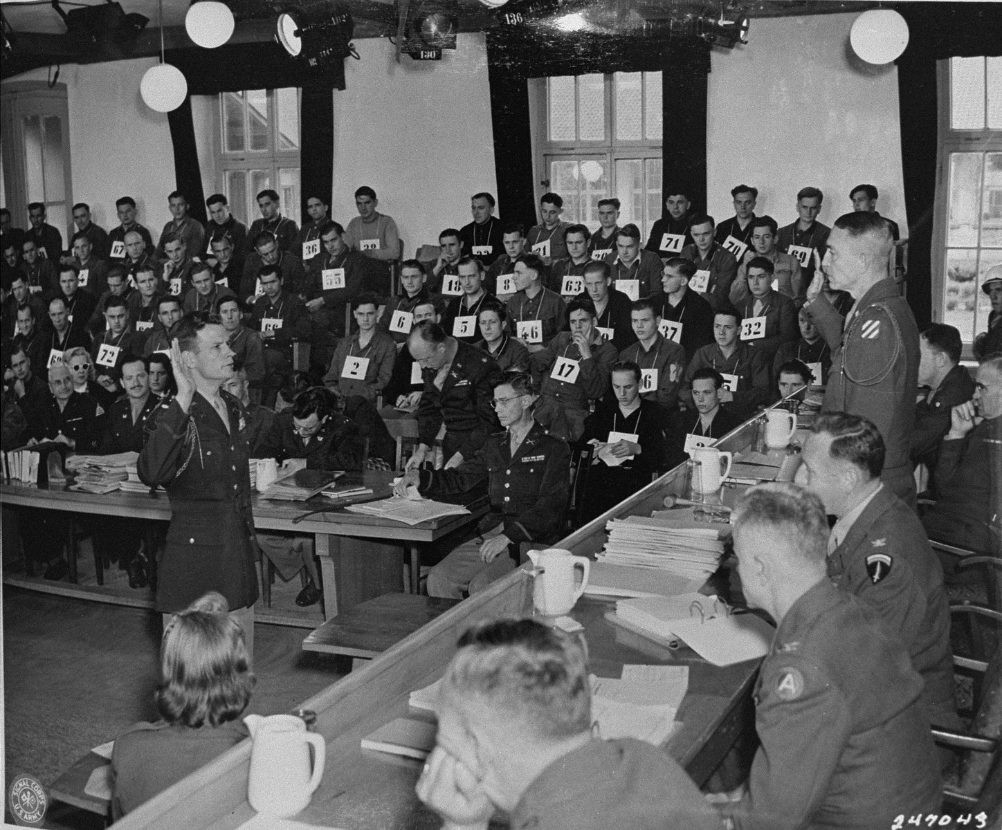 American Lieutenant Colonel Hal. D. McCown is sworn in as a witness for the defense at the trial of 74 SS men charged with perpetrating the Malmedy atrocity.