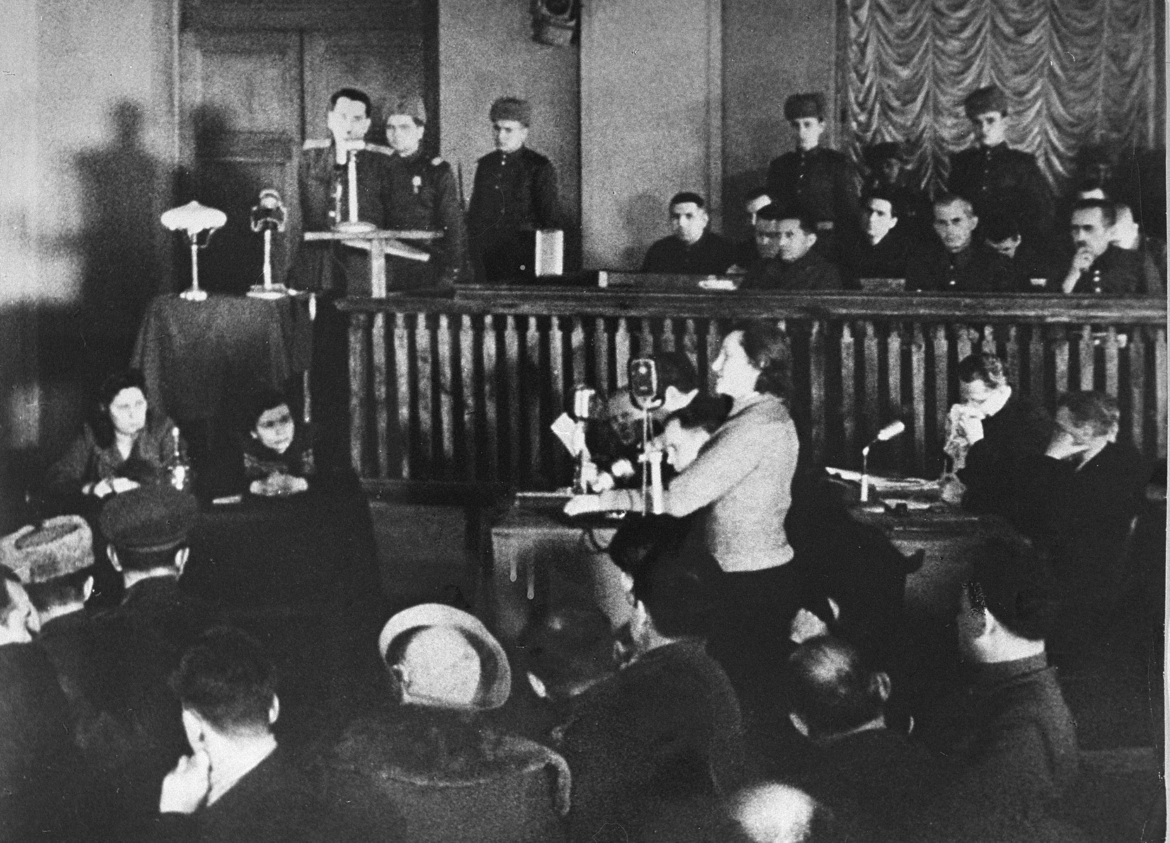 Dina Pronicheva, a Jewish survivor of the Babi Yar massacre, testifies about her experiences during a war crimes trial in Kiev. [Oversized print]