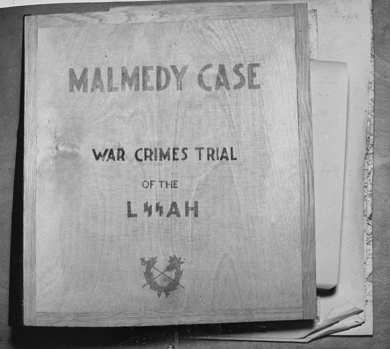 The book containing the indictments and charges against the defendants in the trial of 74 SS men charged with perpetrating the Malmedy atrocity.