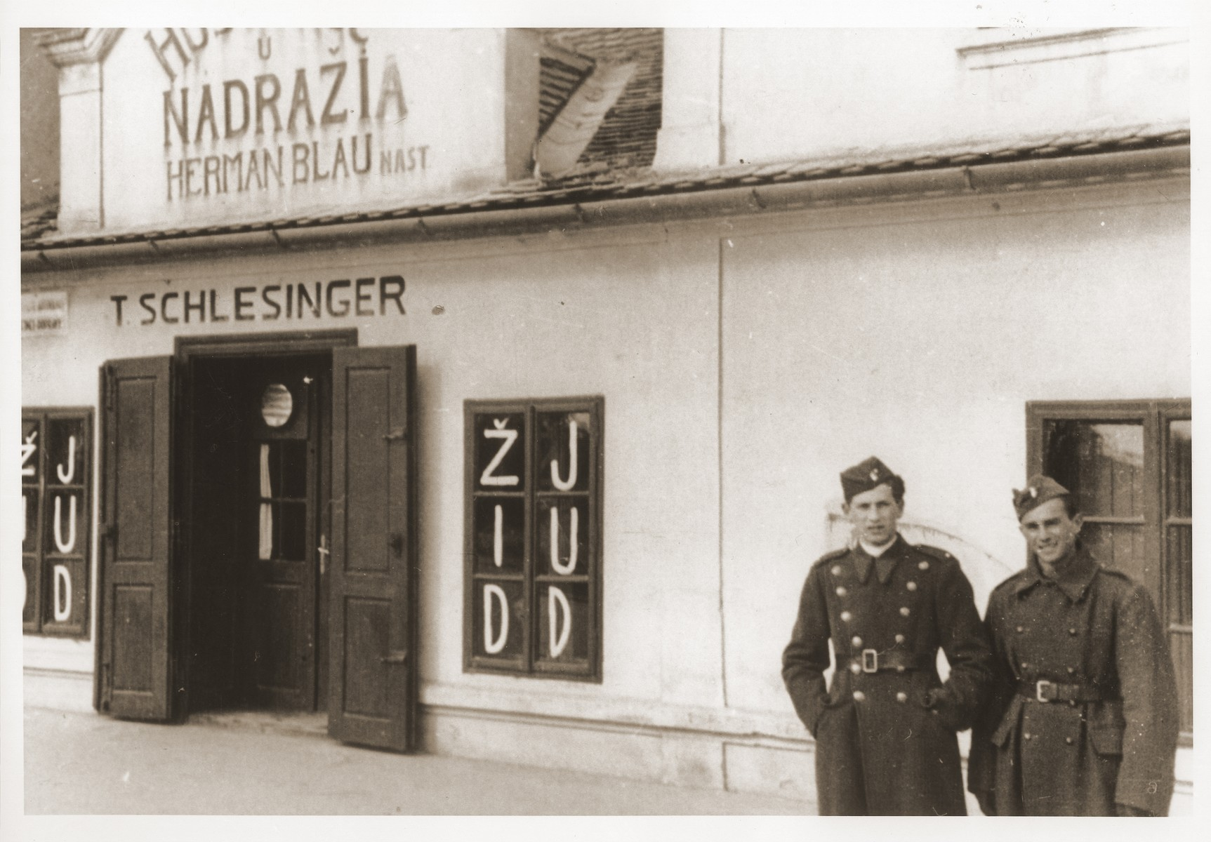 Laco Fischer in front of a store painted with anti-Jewish graffiti in Bratislava.