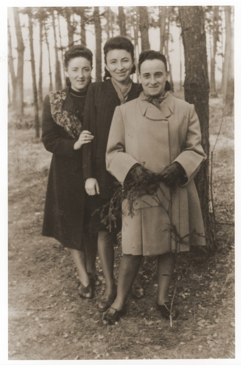 Gittel Trzcina (left) with two friends at the Vilseck displaced persons camp.  Gerzon Trzcina was born in Krasnosielc, Poland in 1922.  He was the son of Dina Kassel and Benam Yitzhak, who was a businessman in the leather trade.  Gerzon had one older brother, Jacob, and two sisters, Faiga (b. 1918) and Perl (b. 1920).  When the war broke out, Gerzon was working as a photographer's assistant (among other jobs) in Warsaw.  Following the German invasion of September, 1939, Gerzon was slightly wounded by shrapnel.  Soon after, a drunken German soldier, forcibly cut Gerzon's hair.  When the soldier made him stoop down to pick up the cuttings, Gerzon grabbed the German's gun and ran away.  After a short time in hiding, Gerzon returned to his hometown, where he learned that eighty Jews had been murdered in the synagogue during the first week of the war in one of the first large-scale atrocities against Polish Jews.  Among those killed was Gerzon's eighty-two-year-old grandfather, Haskel Kassel.  Gerzon moved on to Makow Mazowiecki, where he was forced to clean the stables the Germans had set up in the town's synagogue.  In the late fall, Gerzon escaped with his family to Bialystok, where he worked in a tannery until the family was deported to the Soviet interior in June, 1940.  Along with a group of Polish and Jewish refugees, the Trzcinas were sent to the Kiltovo labor camp in northern Russia.  Harsh conditions and poor nutrition led to Gerzon's father's death in the camp.  The family remained in Kiltovo until the German invasion of the Soviet Union in June of 1941.  Soon after, the refugees were allowed to leave the camp, and the Trzcinas moved to nearby Syktyvkar (capital of the Komi republic), where Gerzon worked in a construction company and later in a tannery.  In Syktyvkar, Gerzon was reunited with Gittel Blankitner, a Jewish refugee from Mlawa, whom he had met earlier in his travels in the Soviet Union.  (Gittel's father perished in Aushwitz, and her mother and siblings were killed in Treblinka.) In November, 1944, Gerzon and Gittel were married. The couple left the Soviet Union with their new baby in 1946.  Returning for a brief time to Poland, the family soon joined the wave of survivors streaming toward the Western zones of occupation.  After their arrival in Germany, the Trzcinas stayed in several DP camps including Vilseck, Wurzburg and Lechfeld, where Gerzon worked as an UNRRA photographer.  In March 1951, the family immigrated to the United States.