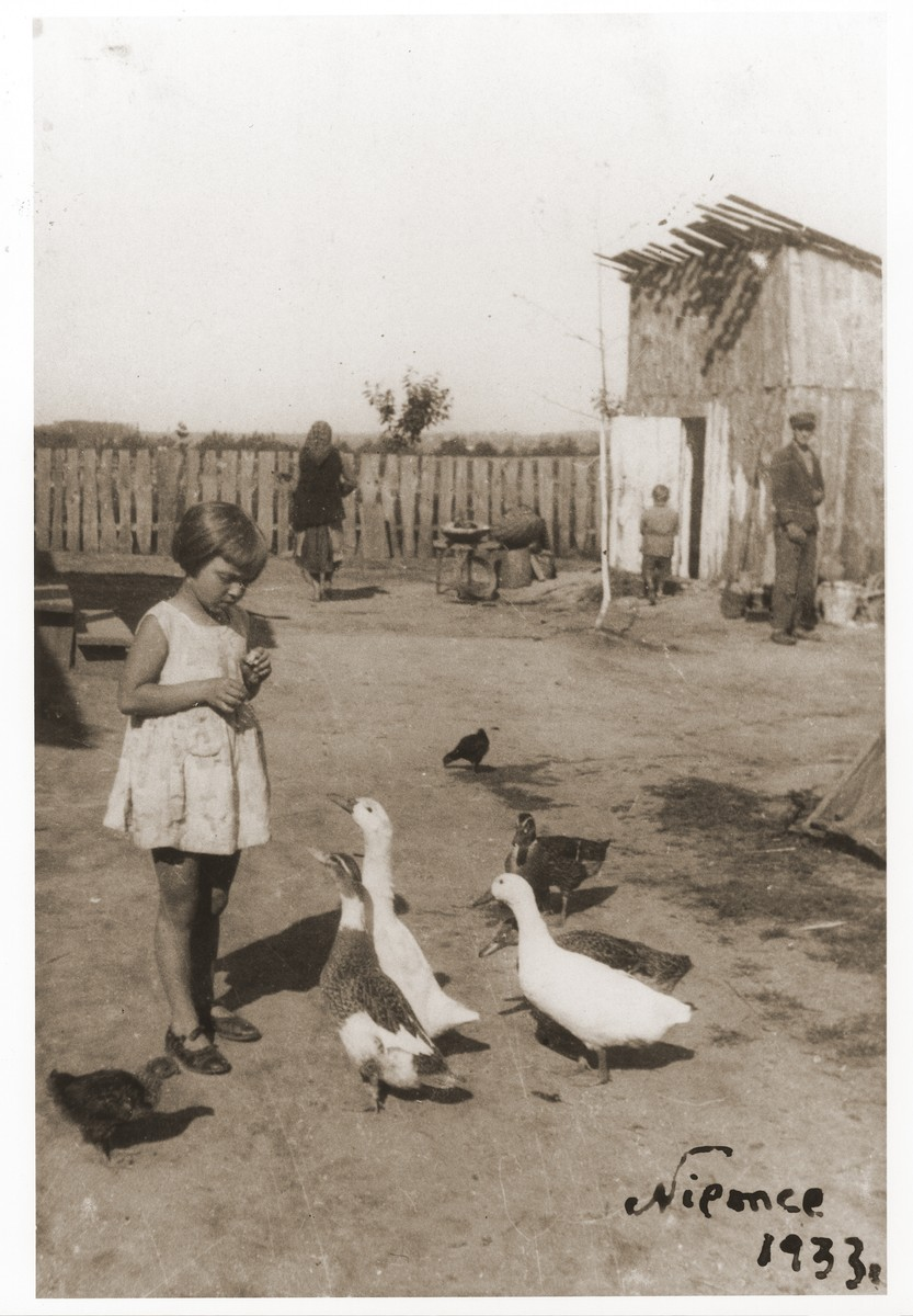 Saba Fiszman feeds some geese while on vacation in Niemce.