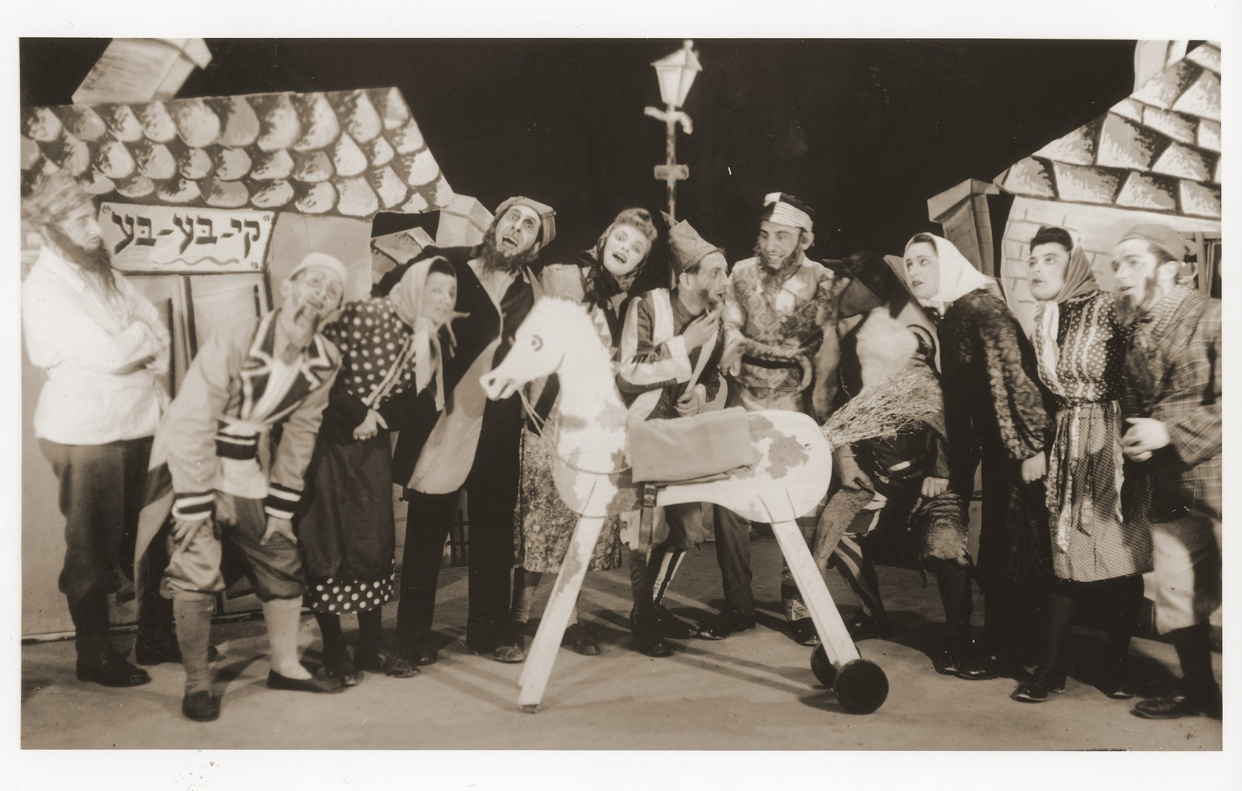 Leah Fischer (third from the right) acts in a performance of Tevye in the Feldafing displaced persons camp.  Also pictured are Chaim Einhorn, second from left and Sonia Flato, fifth from left
