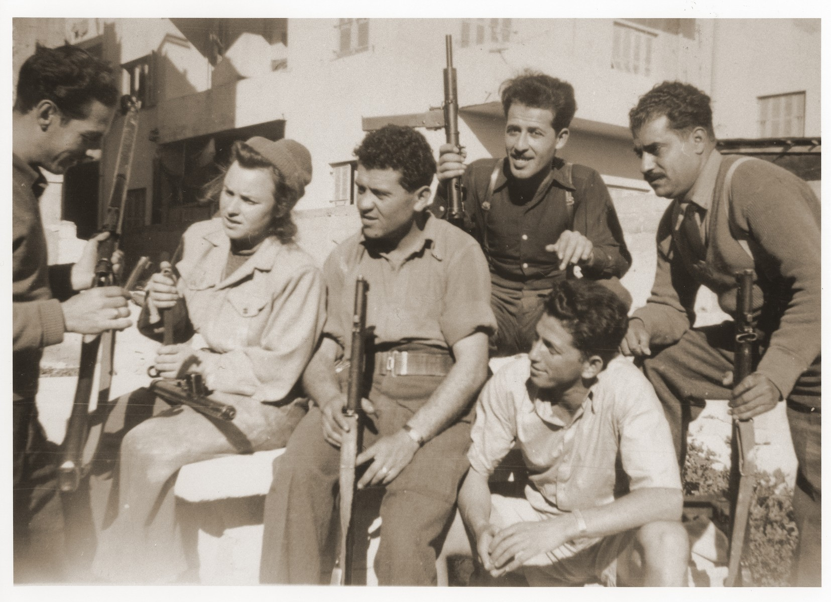 Members of a Haganah unit are taught how to use their rifles.  Among those pictured is Saba Fiszman.