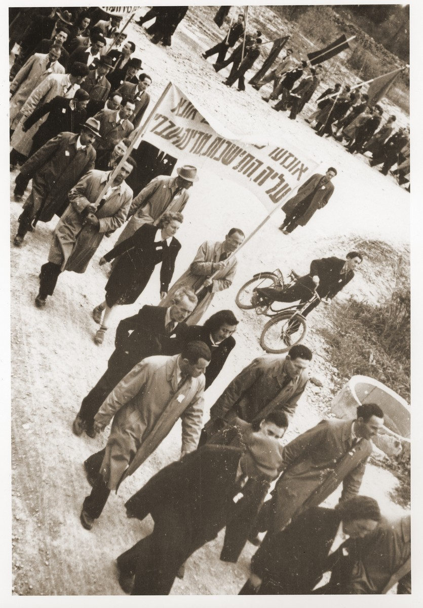Residents of the Feldafing displaced persons camp participate in a protest march demanding unrestricted immigration to Palestine and the creation of a Jewish state.