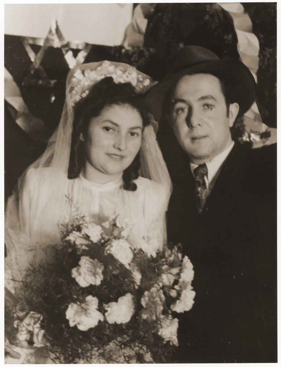 Wedding portrait of Yossel Vilner and Rivke Lefkovitch in the Lechfeld displaced persons camp.  Gerzon Trzcina (now George Gerzon) was born in Krasnosielc, Poland in 1922.  He was the son of Dina Kassel and Benam Yitzhak, who was a businessman in the leather trade.  Gerzon had one older brother, Jacob, and two sisters, Faiga (b. 1918) and Perl (b. 1920).  When the war broke out, Gerzon was working as a photographer's assistant (among other jobs) in Warsaw.  Following the German invasion of September, 1939, Gerzon was slightly wounded by shrapnel.  Soon after, a drunken German soldier, forcibly cut Gerzon's hair.  When the soldier made him stoop down to pick up the cuttings, Gerzon grabbed the German's gun and ran away.  After a short time in hiding, Gerzon returned to his hometown, where he learned that eighty Jews had been murdered in the synagogue during the first week of the war in one of the first large-scale atrocities against Polish Jews.  Among those killed was Gerzon's eighty-two-year-old grandfather, Haskel Kassel.  Gerzon moved on to Makow Mazowiecki, where he was forced to clean the stables the Germans had set up in the town's synagogue.  In the late fall, Gerzon escaped with his family to Bialystok, where he worked in a tannery until the family was deported to the Soviet interior in June, 1940.  Along with a group of Polish and Jewish refugees, the Trzcinas were sent to the Kiltovo labor camp in northern Russia.  Harsh conditions and poor nutrition led to Gerzon's father's death in the camp.  The family remained in Kiltovo until the German invasion of the Soviet Union in June of 1941.  Soon after, the refugees were allowed to leave the camp, and the Trzcinas moved to nearby Syktyvkar (capital of the Komi republic), where Gerzon worked in a construction company and later in a tannery.  In Syktyvkar, Gerzon was reunited with Gittel Blankitner, a Jewish refugee from Mlawa, whom he had met earlier in his travels in the Soviet Union.  (Gittel's father perished in Aushwitz, and her mother and siblings were killed in Treblinka.) In November, 1944, Gerzon and Gittel were married. The couple left the Soviet Union with their new baby in 1946.  Returning for a brief time to Poland, the family soon joined the wave of survivors streaming toward the Western zones of occupation.  After their arrival in Germany, the Trzcinas stayed in several DP camps including Vilseck, Wurzburg and Lechfeld, where Gerzon worked as an UNRRA photographer.  In March 1951, the family immigrated to the United States.