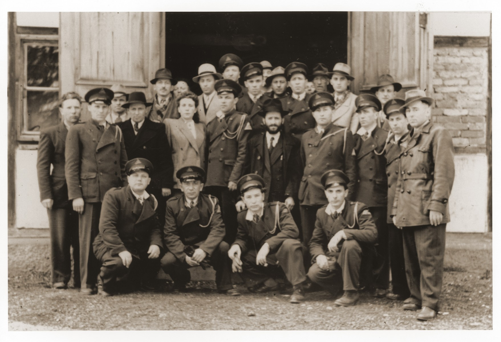 Group portrait of Jewish DP police and others from the Lechfeld displaced persons camp at a memorial ceremony in Dachau.