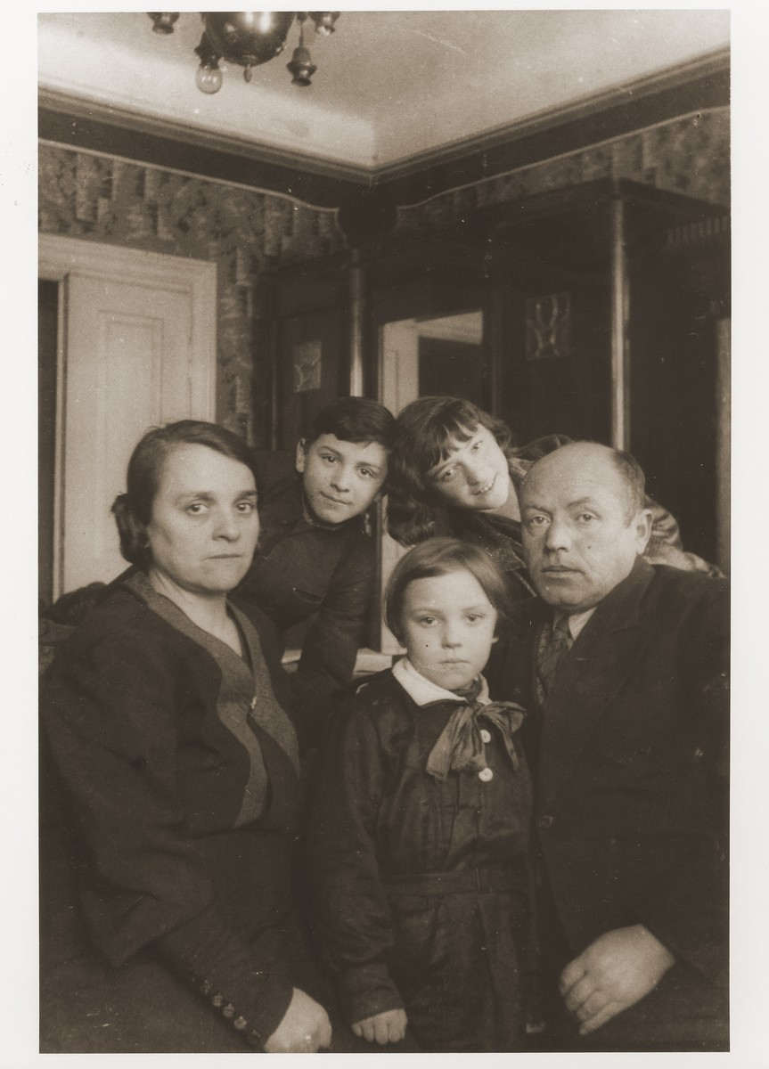 Aron and Ester Fiszman with their three younger children, Zosia, Julek and Saba, in their home in Lublin.