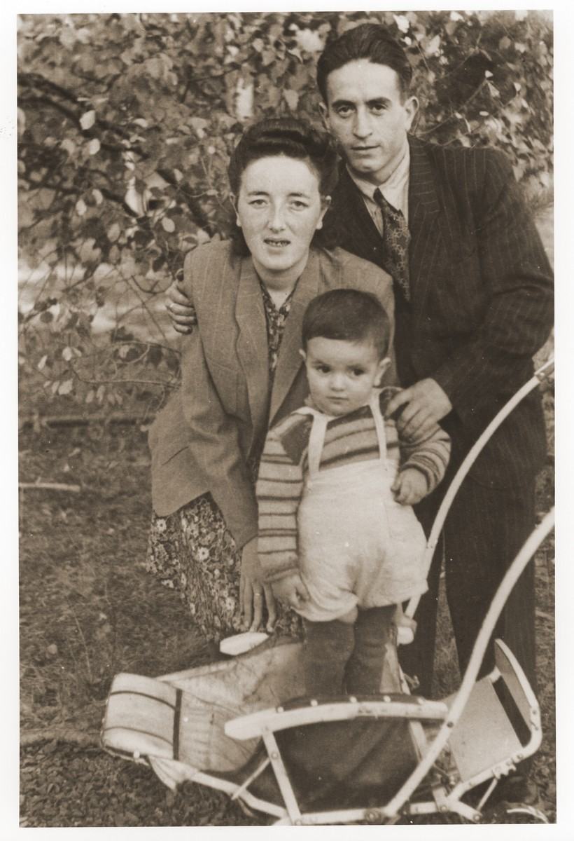 Gerzon and Gittel Trzcina with their son, Benjamin, in the Vilseck displaced persons camp.  Gerzon Trzcina was born in Krasnosielc, Poland in 1922.  He was the son of Dina Kassel and Benam Yitzhak, who was a businessman in the leather trade.  Gerzon had one older brother, Jacob, and two sisters, Faiga (b. 1918) and Perl (b. 1920).  When the war broke out, Gerzon was working as a photographer's assistant (among other jobs) in Warsaw.  Following the German invasion of September, 1939, Gerzon was slightly wounded by shrapnel.  Soon after, a drunken German soldier, forcibly cut Gerzon's hair.  When the soldier made him stoop down to pick up the cuttings, Gerzon grabbed the German's gun and ran away.  After a short time in hiding, Gerzon returned to his hometown, where he learned that eighty Jews had been murdered in the synagogue during the first week of the war in one of the first large-scale atrocities against Polish Jews.  Among those killed was Gerzon's eighty-two-year-old grandfather, Haskel Kassel.  Gerzon moved on to Makow Mazowiecki, where he was forced to clean the stables the Germans had set up in the town's synagogue.  In the late fall, Gerzon escaped with his family to Bialystok, where he worked in a tannery until the family was deported to the Soviet interior in June, 1940.  Along with a group of Polish and Jewish refugees, the Trzcinas were sent to the Kiltovo labor camp in northern Russia.  Harsh conditions and poor nutrition led to Gerzon's father's death in the camp.  The family remained in Kiltovo until the German invasion of the Soviet Union in June of 1941.  Soon after, the refugees were allowed to leave the camp, and the Trzcinas moved to nearby Syktyvkar (capital of the Komi republic), where Gerzon worked in a construction company and later in a tannery.  In Syktyvkar, Gerzon was reunited with Gittel Blankitner, a Jewish refugee from Mlawa, whom he had met earlier in his travels in the Soviet Union.  (Gittel's father perished in Aushwitz, and her m