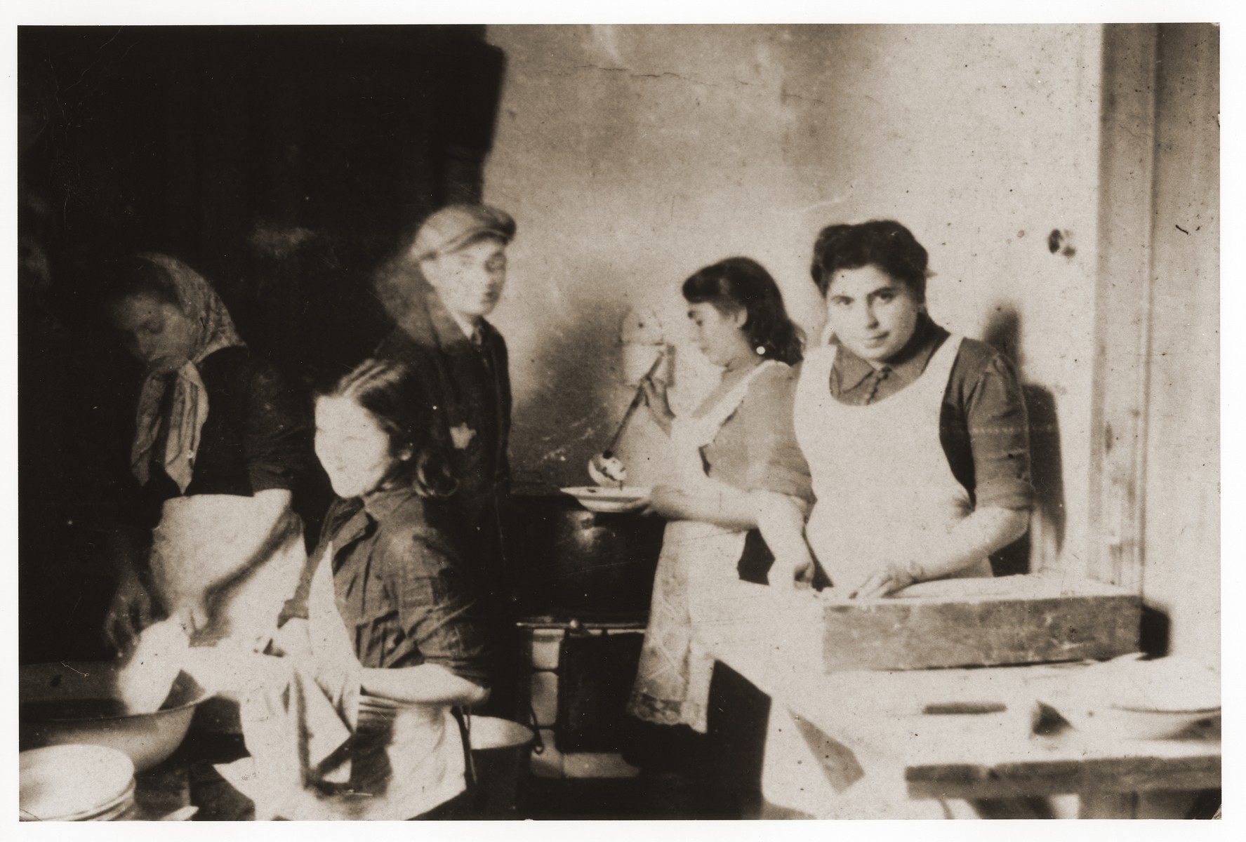 Lodz ghetto residents at work in a public kitchen.