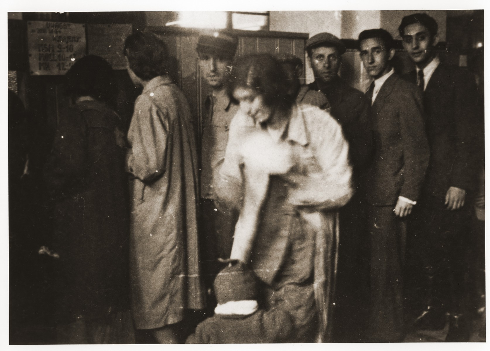 Lodz residents line up at an unidentified office in the ghetto.