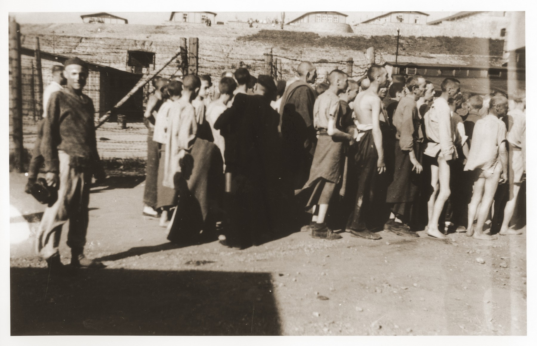 Mauthausen survivors line up for food at the soup kitchen in the 'quarantine camp.'