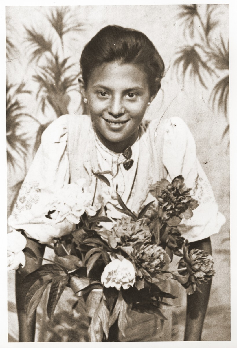 Portrait of Hannah Zelda Shulman while living under an assumed Polish identity during World War II.  Hannah Shulman is the cousin of the donor.